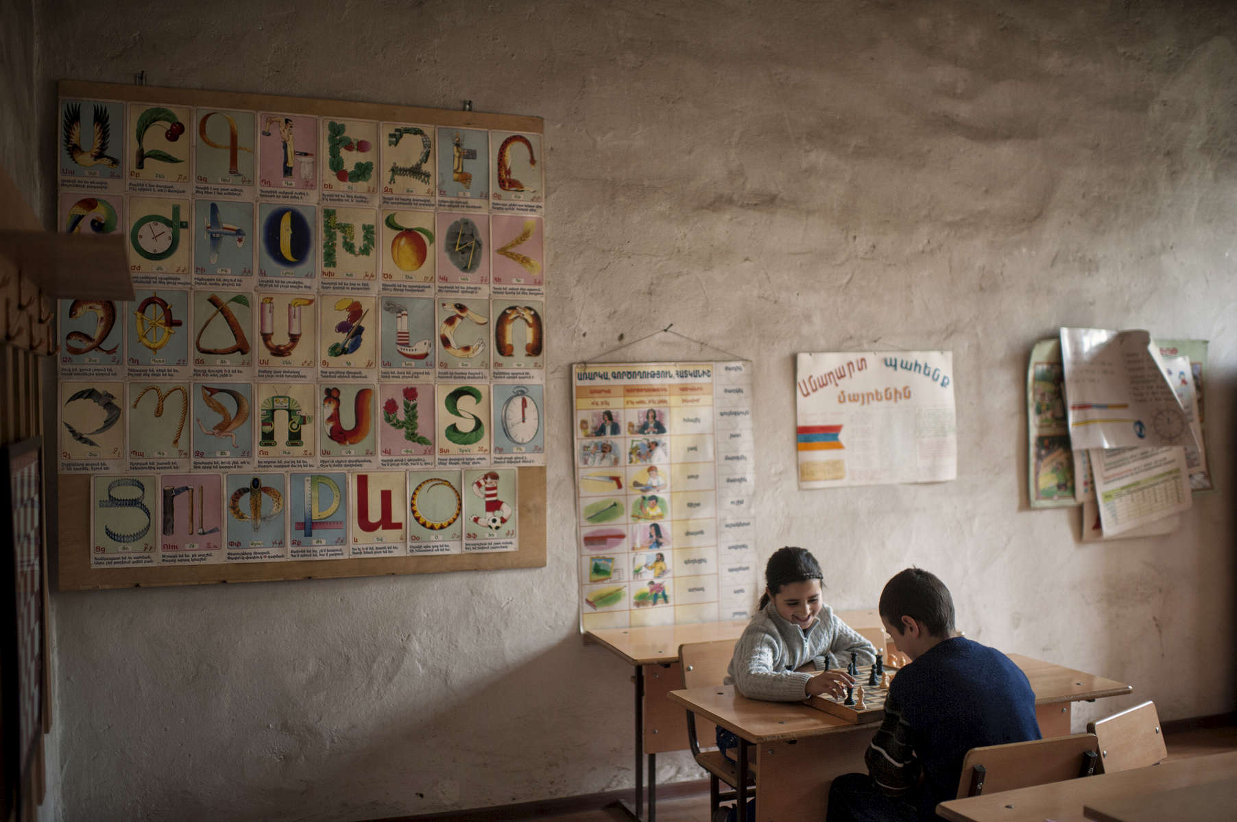Nine year-old Diana Budaghyan beats ten year-old Artur Petrosyan in chess during school in Khtsaberd village. The area is very heavily mined, and HALO is trying to raise the funds to clear the minefields.