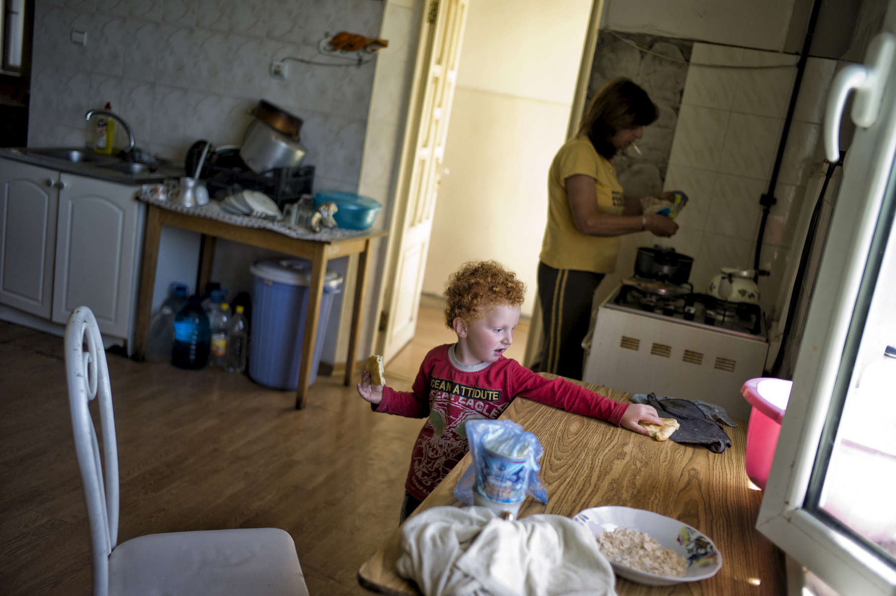 June 14, 2013: LACHIN/BERDZOR, NAGORNO-KARABAKH- Members of several different Syrian Armenian families stand in the kitchen of the guest house they are sharing in the unrecognized Caucasian republic of Nagorno-Karabakh.  Several hundred Syrian-Armenian refugees, mostly from Qamishlii, have moved to the contested republic, where they have been given housing and loans to help them to restart their lives, although most are still struggling - the house they share lacks electricity and work is extremely difficult to come by.   Most families have put their money into farming, but a freak hail storm damaged or destroyed most of this year's crop.  Nagorno-Karabakh, which in the Soviet Union was under the control of Azerbaijan, has been a de facto independent state since the 1988-94 Karabakh War in which its secessionist ethnic-Armenian population, backed by the Republic of Armenia, fought a war against the newly independent Azerbaijan, resulting in major population  shifts as Azeri residents of Karabakh fled to Azerbaijan and ethnic Armenians fled Azerbaijan for the Republic of Armenia.  While the war theoretically ended in 1994, hostilities occasionally flare up, and Karabakh's final status is far from settled, with Azerbaijan referring to it as occupied territory that it hopes to regain and Armenia controlling the only actual access to the republic. As a result, the movement of Syrian refugees into the territory, although voluntary on the part of the families rather than part of a state-run plan, has the potential to be extremely controversial.  Photo by Scout Tufankjian/Polaris