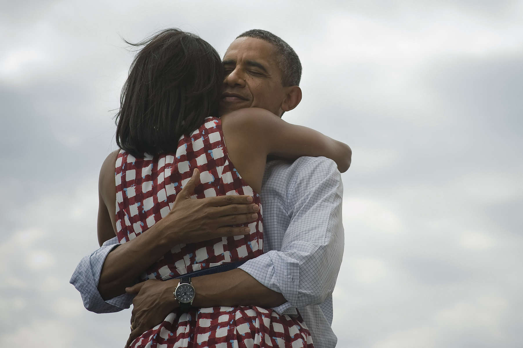 August 15, 2012- DUBUQUE, IA: President Barack Obama and First Lady Michelle Obama embrace onstage at an event in Dubuque, IA. (Scout Tufankjian for Obama for America/Polaris)