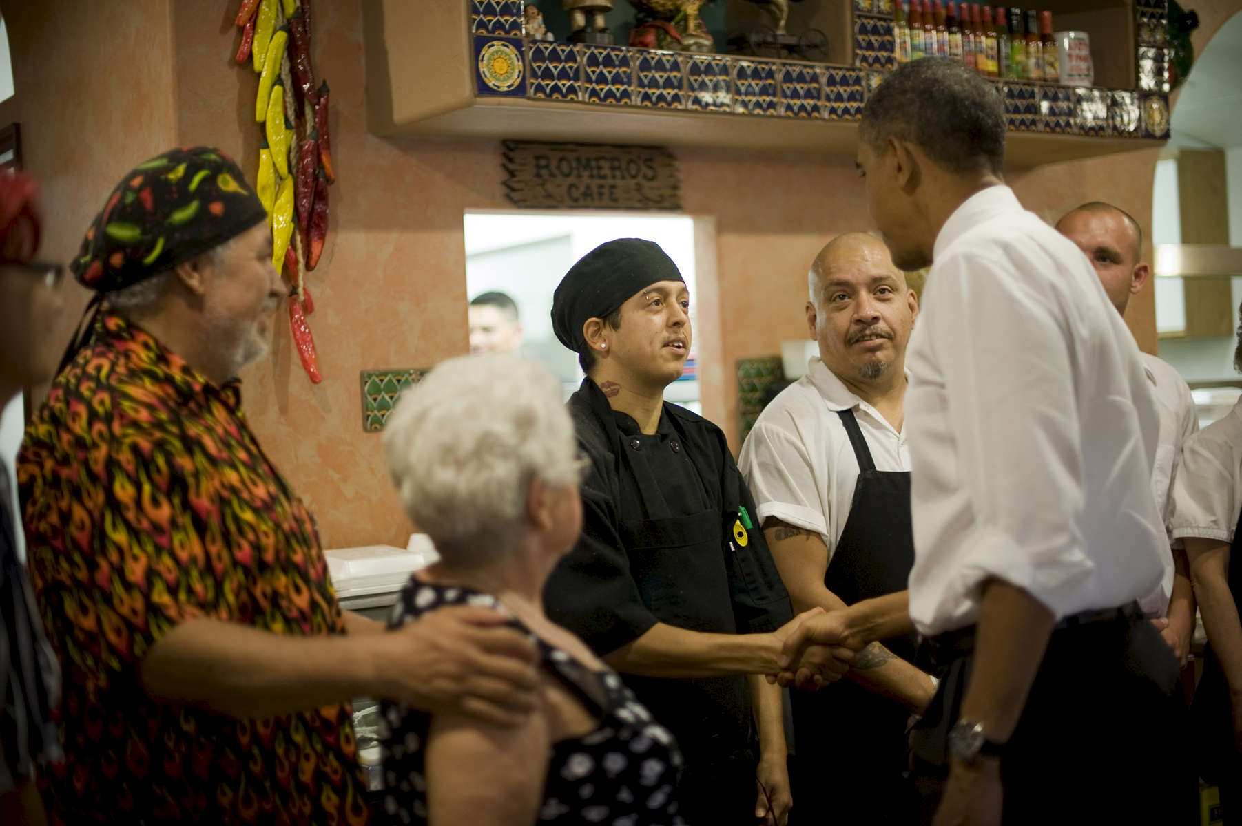 August 9, 2012 - PUEBLO, CO: President Barack Obama greets the staff and owners of Romero's Cafe in Pueblo, Colorado. (Scout Tufankjian for Obama for America/Polaris)