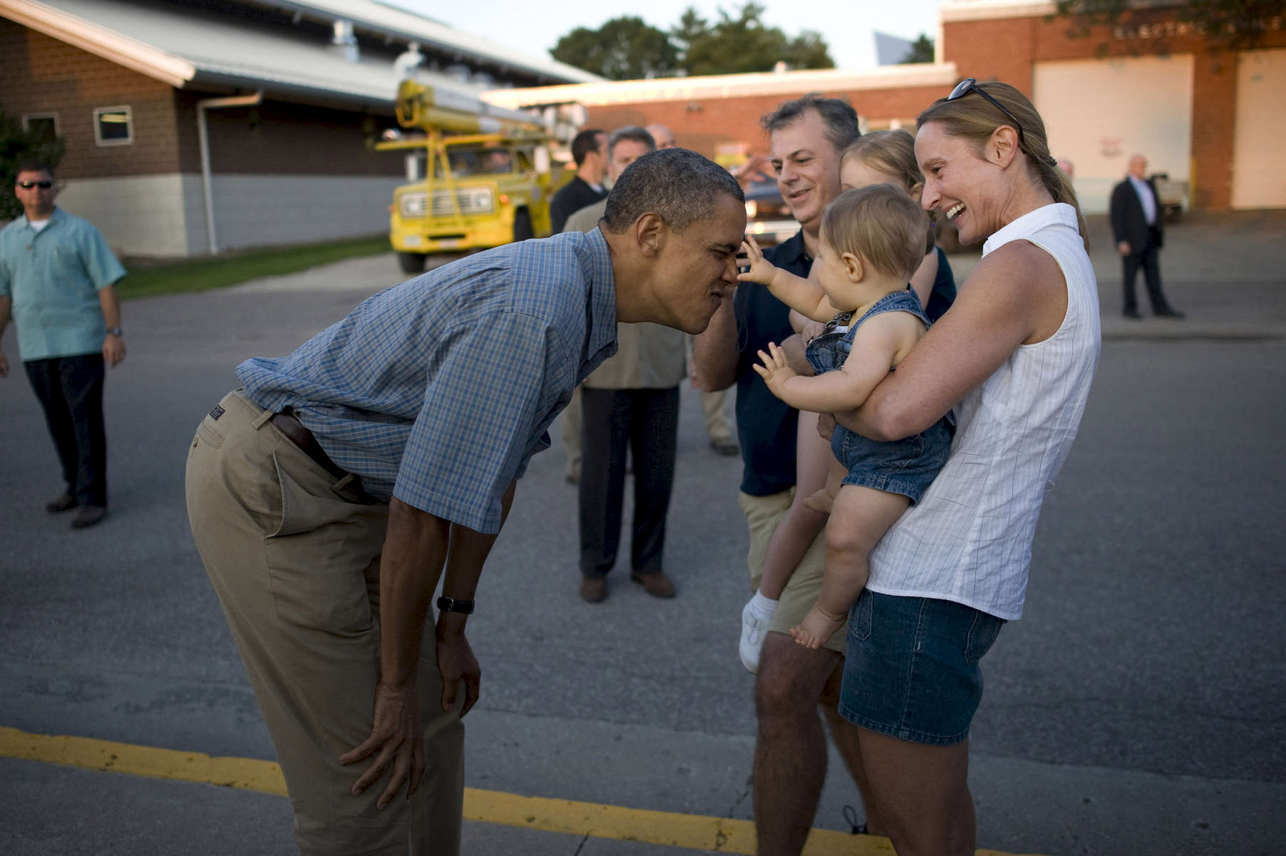 August 13, 2012- Des Moines, IA: A baby reaches out for President Barack Obama as he makes a face at the Iowa State Fair in Des Moines, IA. (Scout Tufankjian for Obama for America/Polaris)