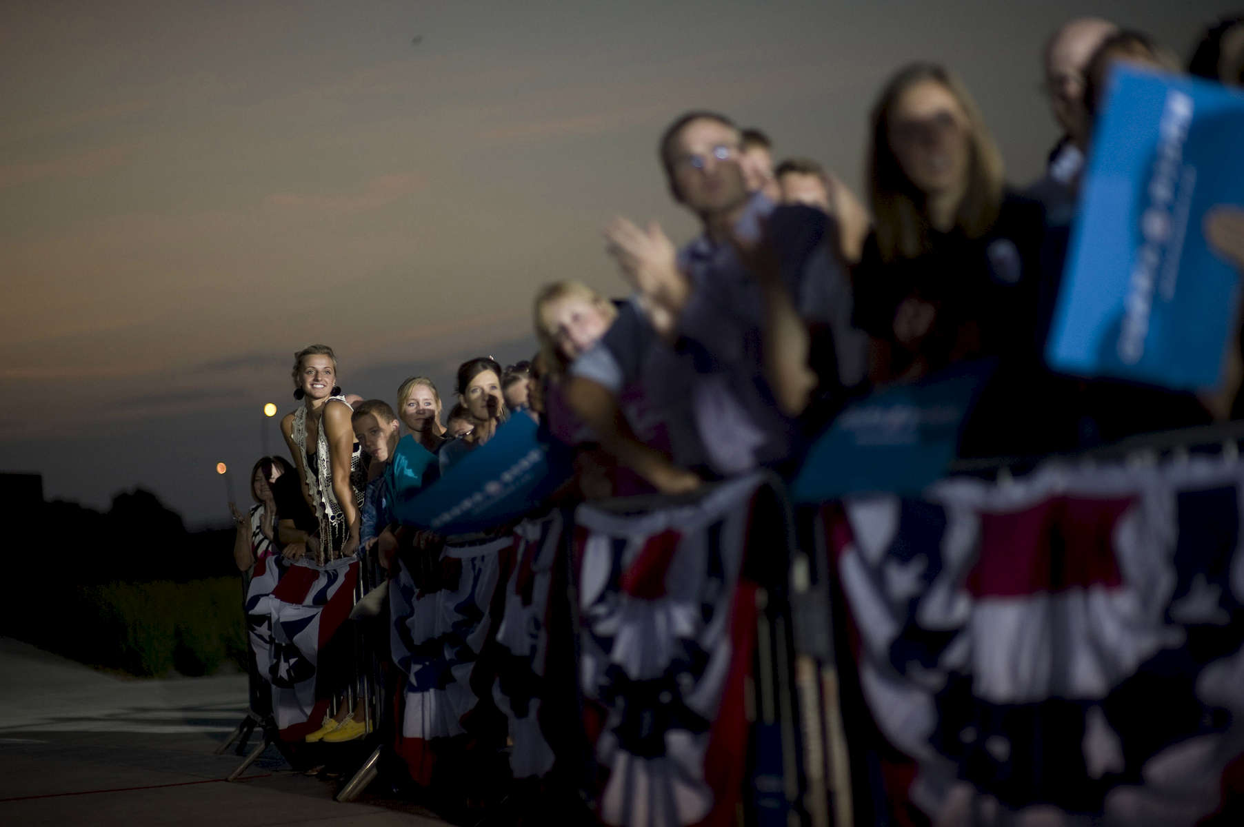 August 14th, 2012 - WATERLOO, IOWA: A young woman leans out in order to better see President Barack Obama as he speaks at an event in Waterloo, IA. (Scout Tufankjian for Obama for America/Polaris)