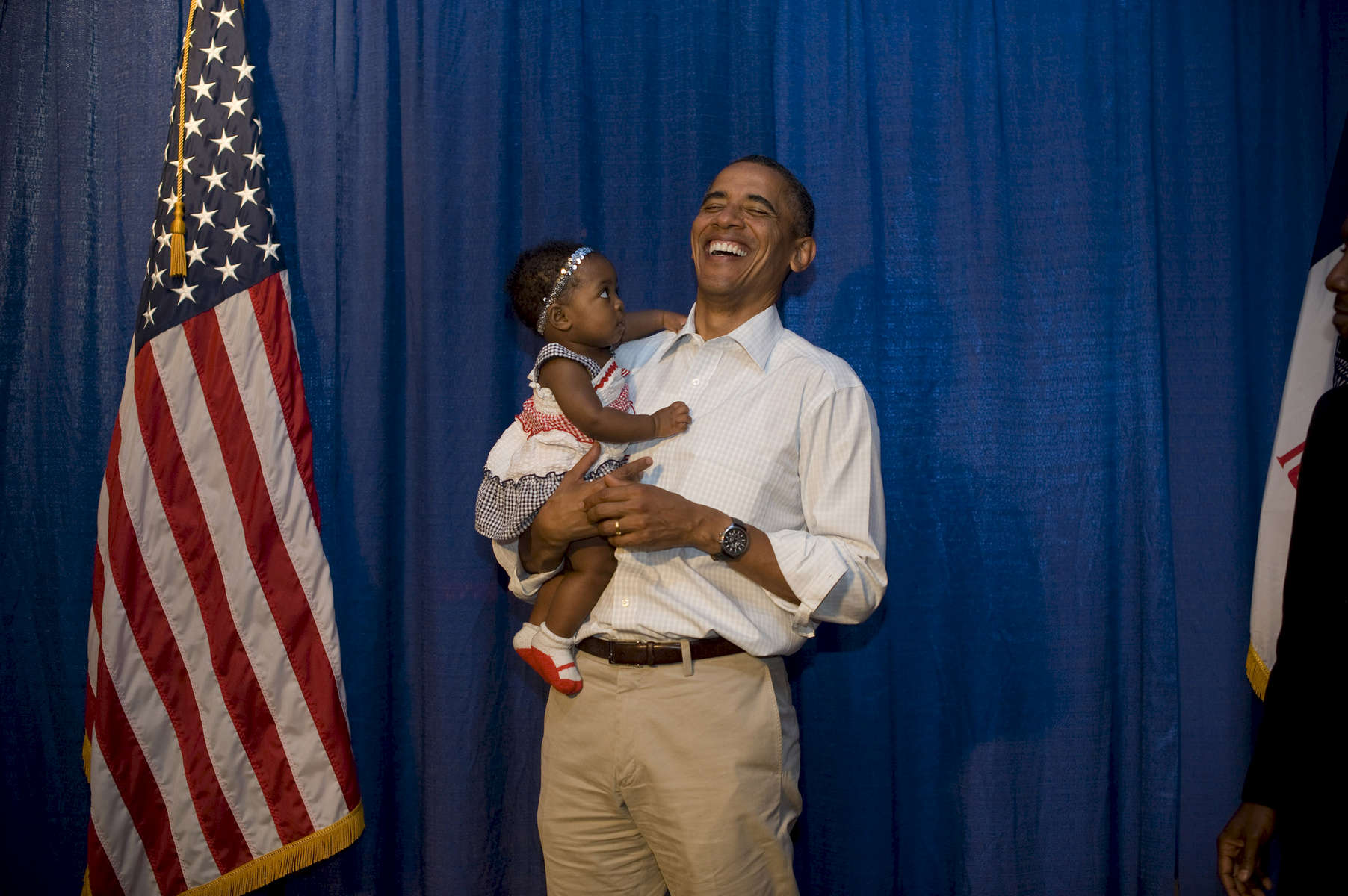 August 14th, 2012 - WATERLOO, IOWA: President Barack Obama laughs as a baby looks up at him suspiciously after an event in Waterloo, IA. (Scout Tufankjian for Obama for America/Polaris)