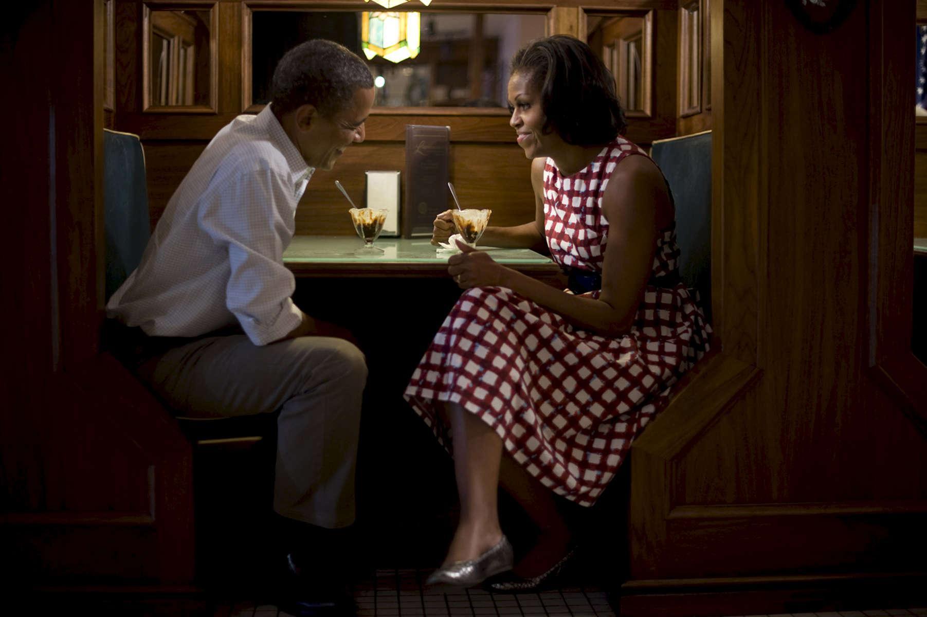 August 15, 2012- DAVENPORT, IA: First Lady Michelle Obama and President Barack Obama share ice cream sundaes at Logomarcino's Ice Cream Shoppe in Davenport, Iowa. (Scout Tufankjian for Obama for America/Polaris)