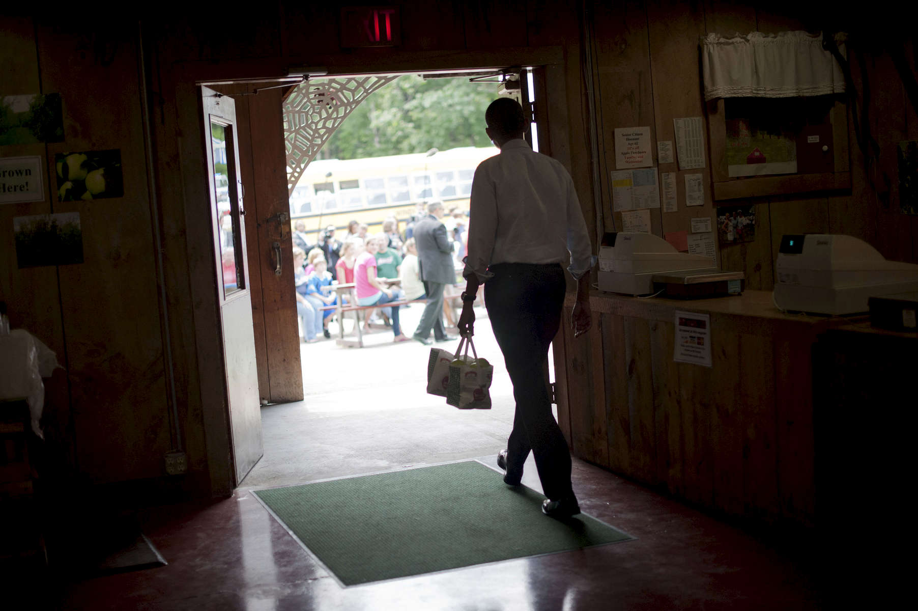 August 18, 2012 - Londonderry, NH: President Barack Obama walks through Mack's Apples in Londonderry, NH after purchasing a few bags of apples.  (Scout Tufankjian for Obama for America/Polaris)