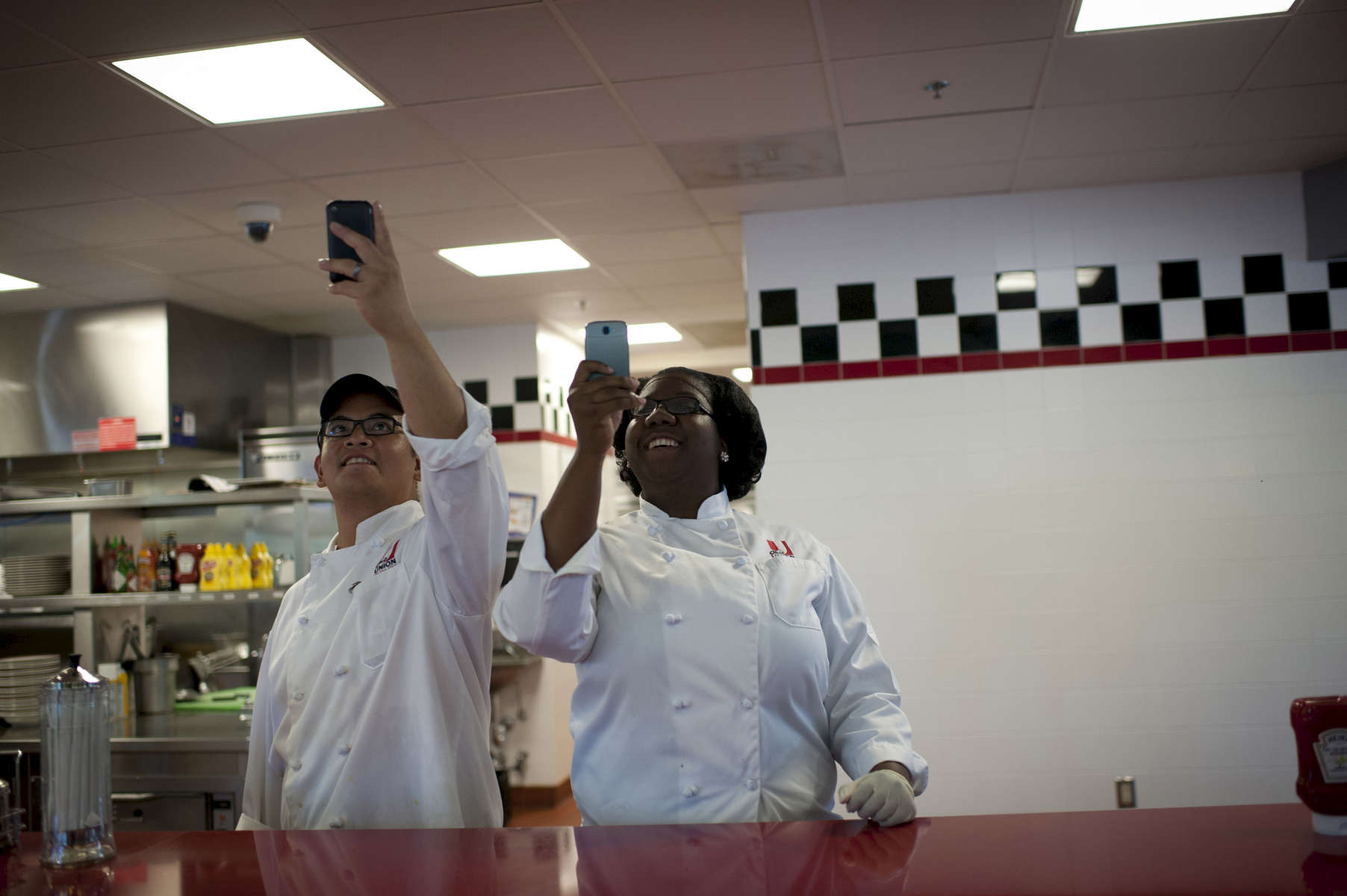August 21, 2012 - COLUMBUS, OH:  Workers at Sloopy's Diner beam as they photograph President Barack Obama with their cell phones during his visit to Columbus, OH. (Scout Tufankjian for Obama for America/Polaris)