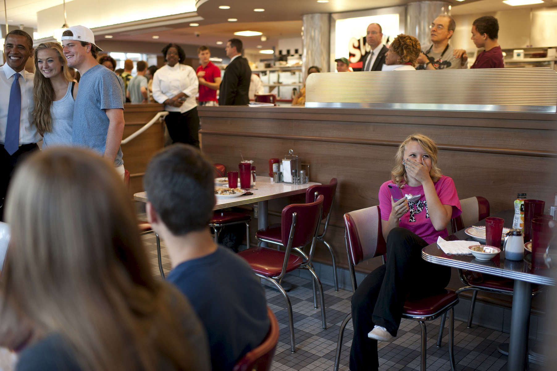 August 21, 2012 - COLUMBUS, OH:  A student reacts as she sees President Barack Obama during his visit to Sloopy's Diner in Columbus, OH. (Scout Tufankjian for Obama for America/Polaris)