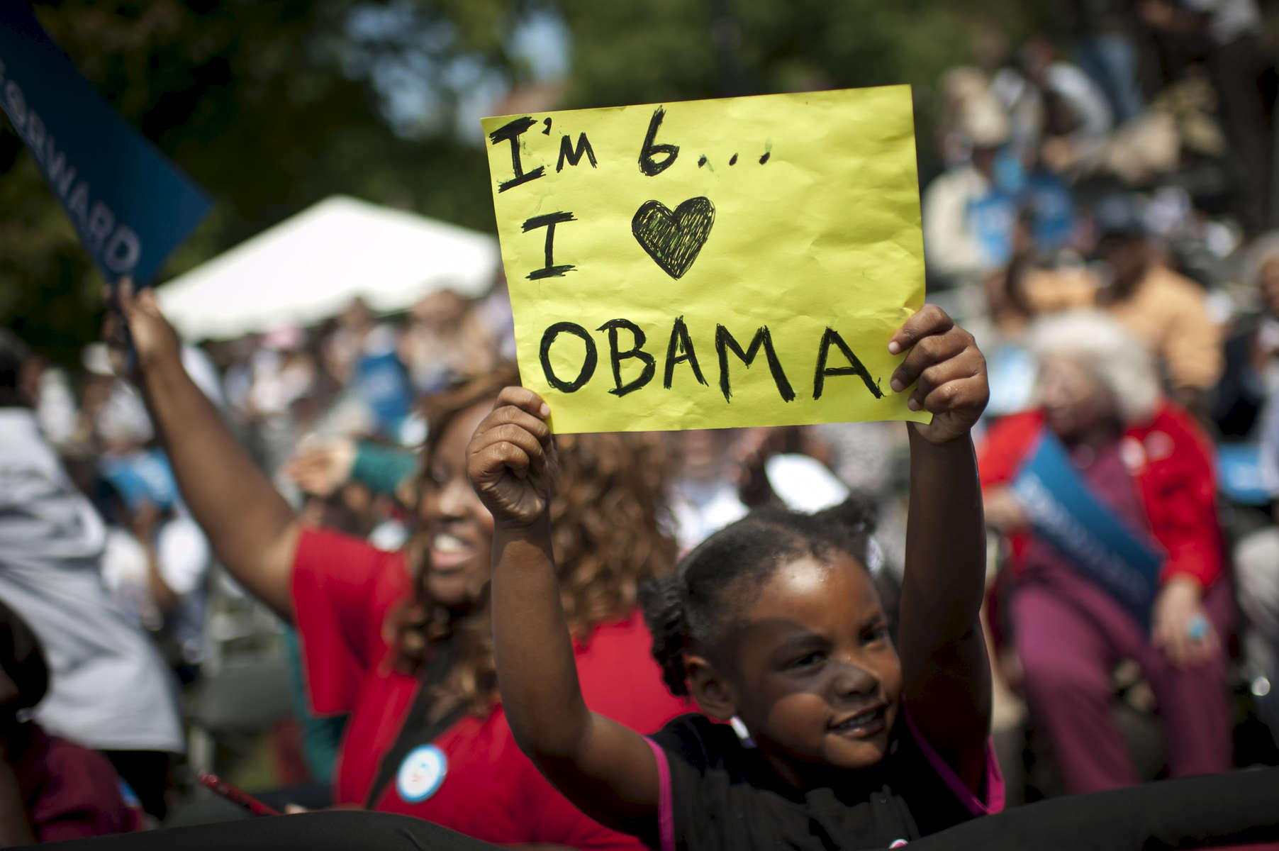 August 21, 2012 - COLUMBUS, OH:  A young girl holds up a sign read {quote}I'm 6…I (heart) OBAMA{quote} during a campaign event in Columbus, OH. (Scout Tufankjian for Obama for America/Polaris)