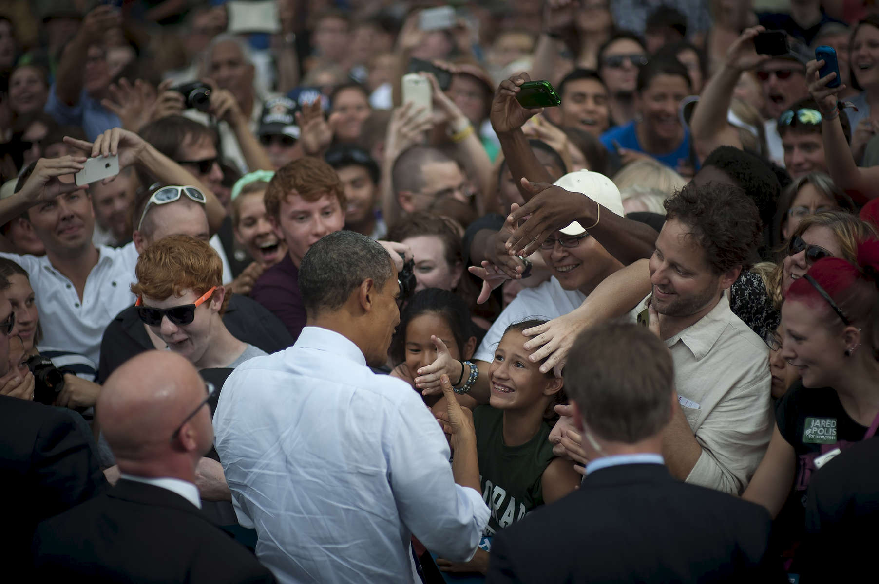 August 28, 2012- Fort Collins, CO:  A young girl grins up at President Barack Obama at a campaign event in Fort Collins, CO.  (Scout Tufankjian for Obama for America/Polaris)