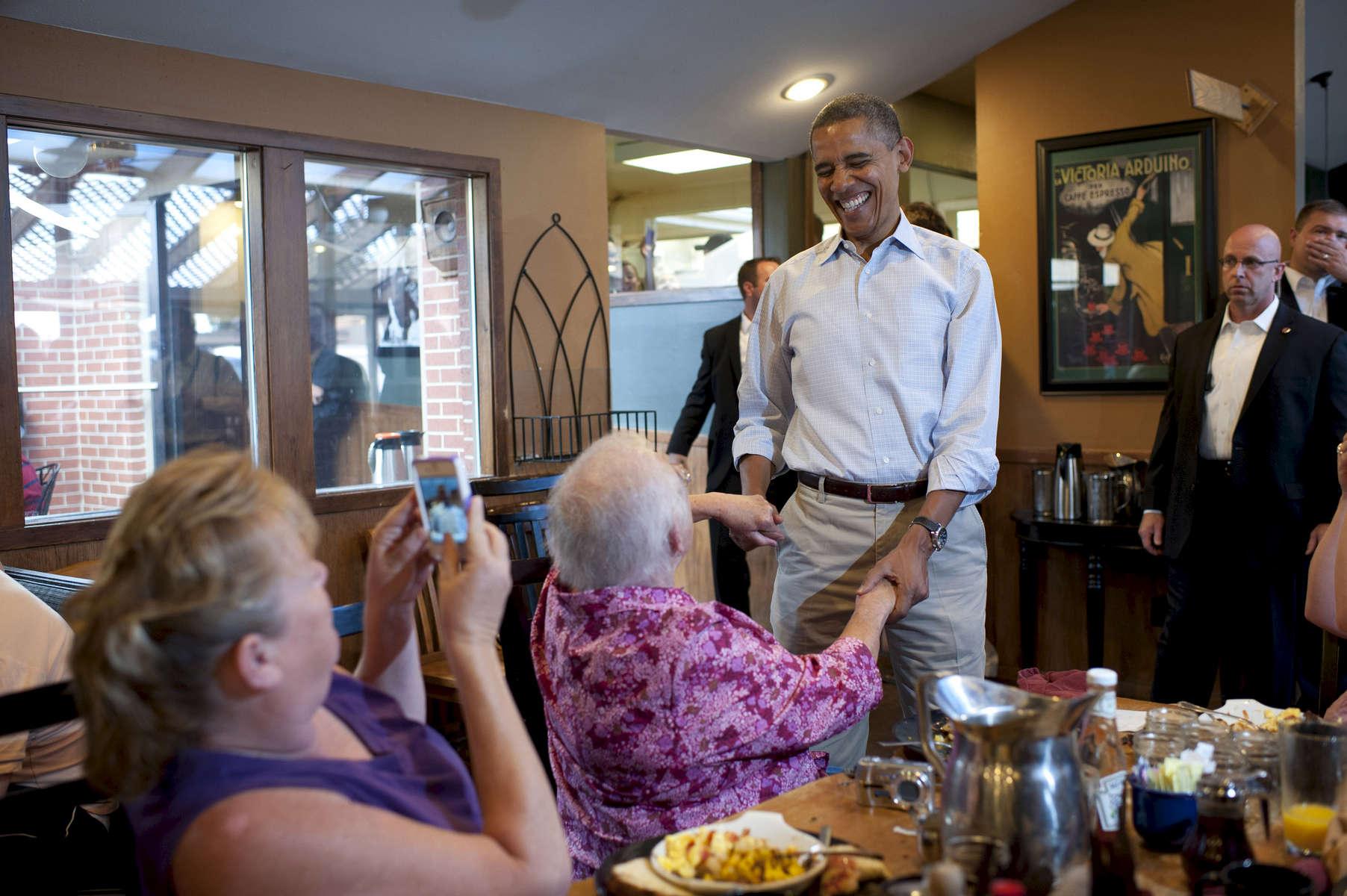 September 2, 2012 - Boulder, CO: President Barack Obama greets patrons at The Buff in Boulder, CO. (Scout Tufankjian for Obama for America/Polaris)