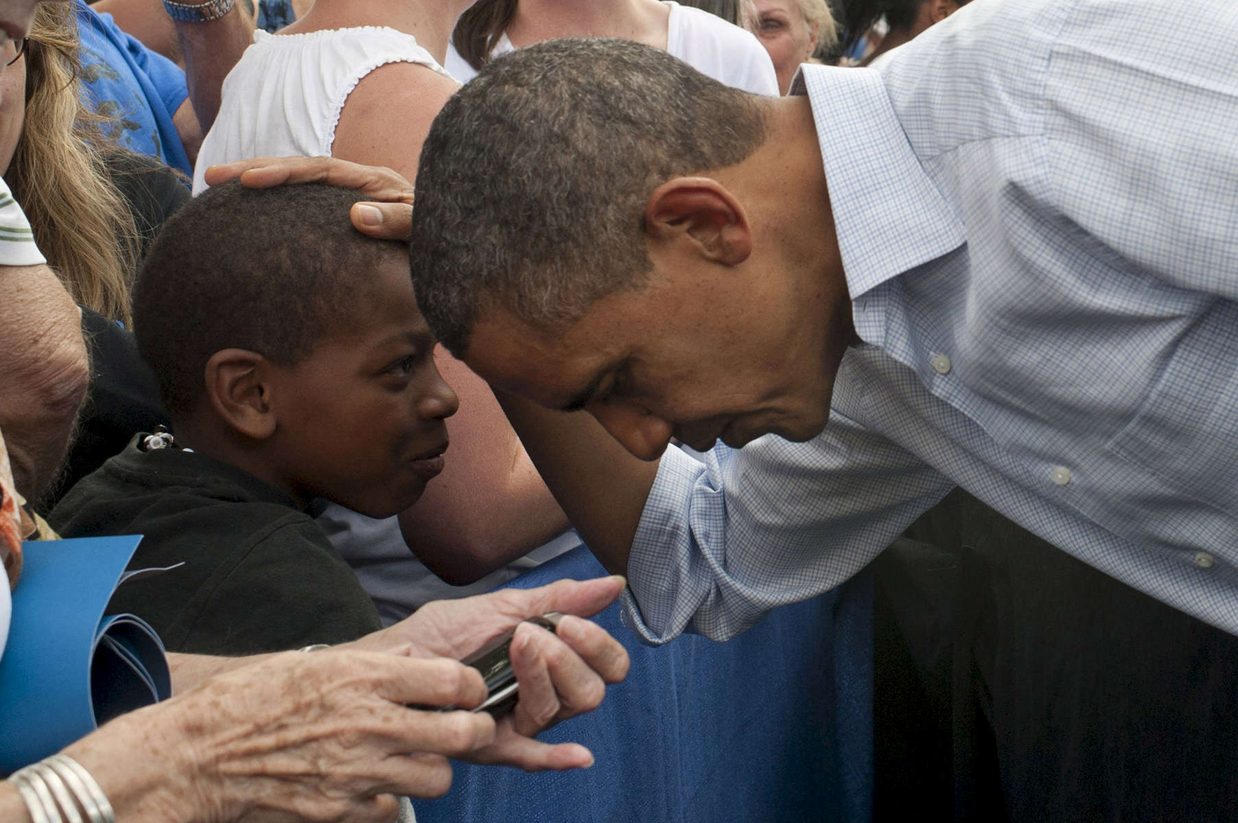 September 2, 2012 - Boulder, CO: President Barack Obama greets a young boy after speaking at a campaign event at the University of Colorado Boulder. (Scout Tufankjian for Obama for America/Polaris)