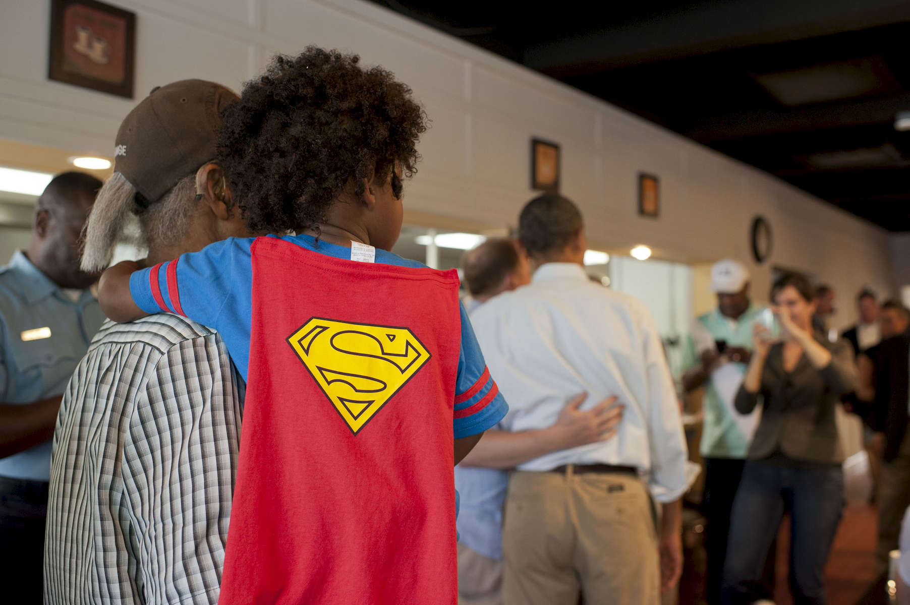 September 3, 2012 - TOLEDO, OH: A young boy in a Superman costume waits to meet President Barack Obama during his visit to Rick's City Diner in Toledo, OH. (Scout Tufankjian for Obama for America/Polaris)