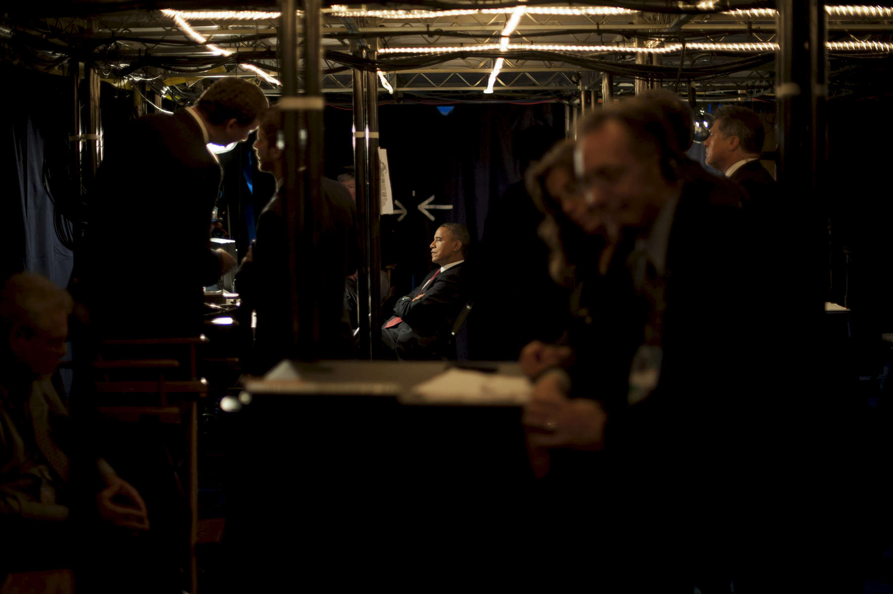 September 5, 2012 - CHARLOTTE, NC: President Barack Obama sits backstage as he listens to former President Bill Clinton speak at the Democratic National Convention. (Scout Tufankjian for Obama for America/Polaris)