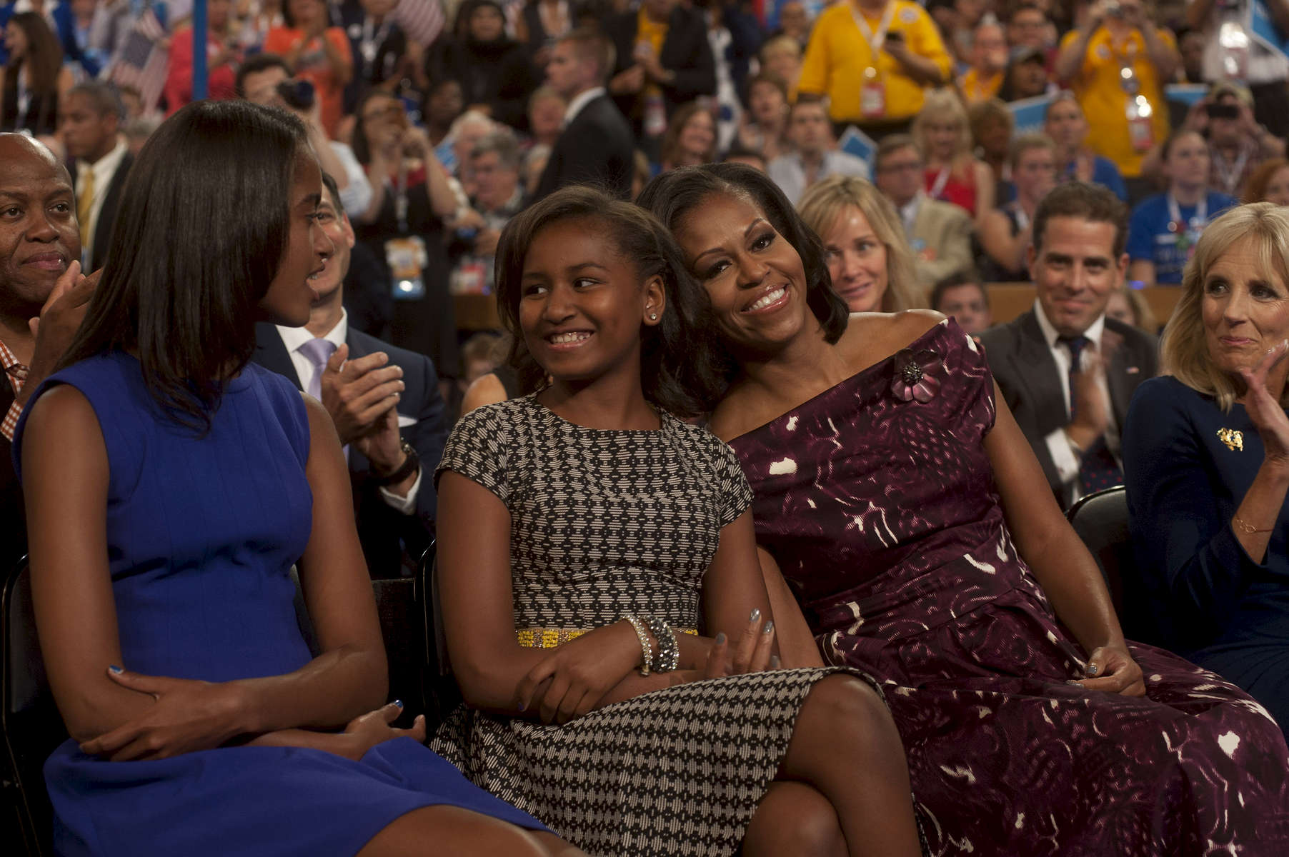 September 6, 2012 - CHARLOTTE, NC: First Lady Michelle Obama bumps heads affectionately with her youngest daughter Sasha as her oldest daughter Malia looks on, during President Barack Obama's speech at the 2012 Democratic National Convention in Charlotte. (Scout Tufankjian for Obama for America/Polaris)
