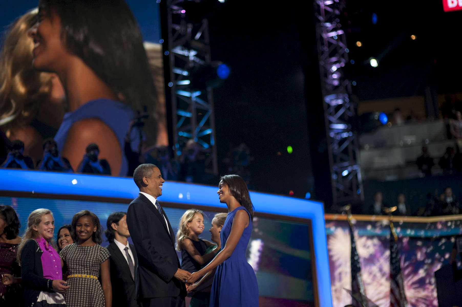 September 6, 2012 - CHARLOTTE, NC: President Barack Obama holds hands with his oldest daughter Malia after his speech at the 2012 Democratic National Convention in Charlotte. (Scout Tufankjian for Obama for America/Polaris)