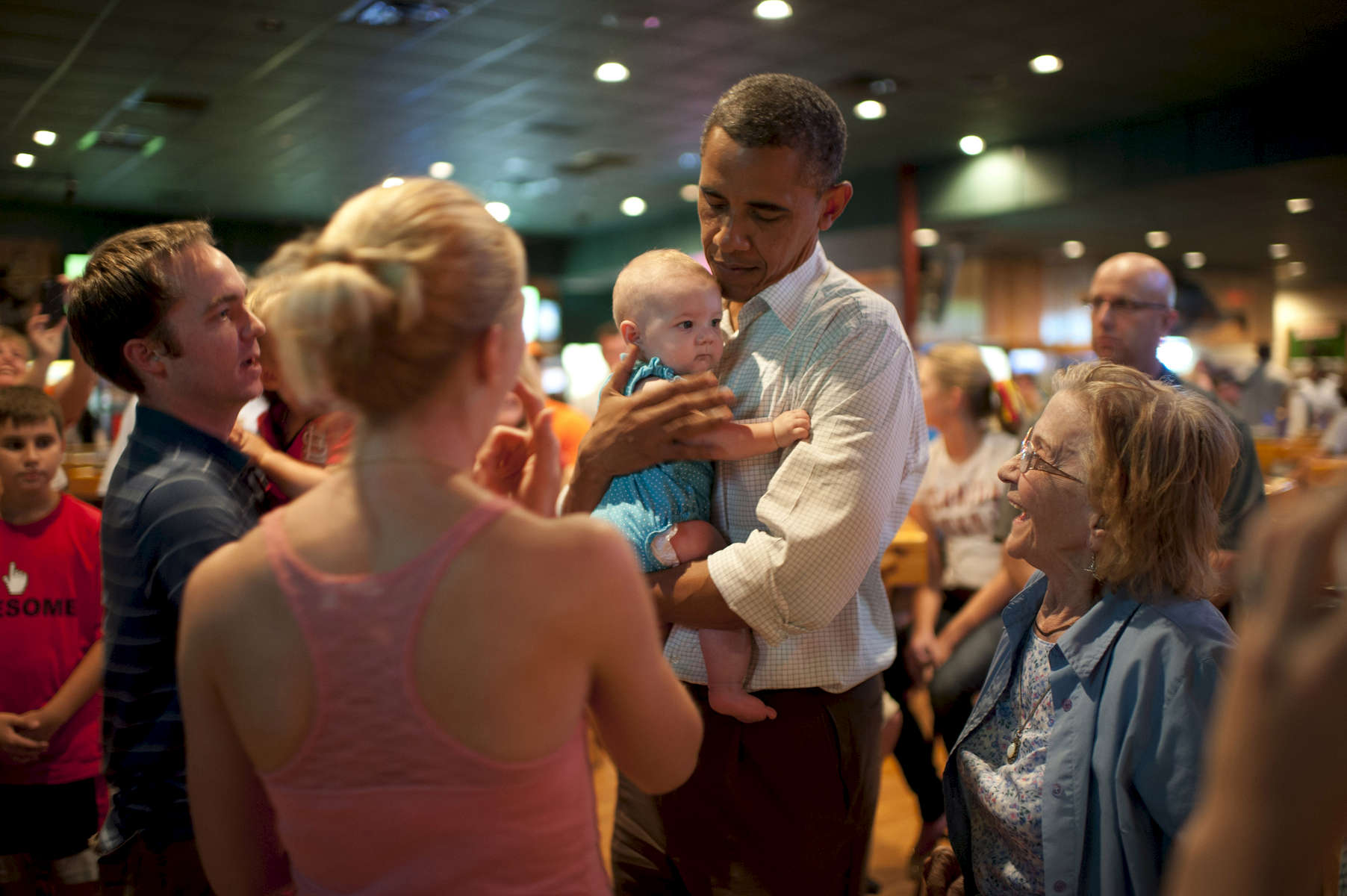 September 8th, 2012 - Orlando, FL: President Barack Obama holds a small baby at Gator's Dockside sports bar in Orlando, FL. (Scout Tufankjian for Obama for America/Polaris)