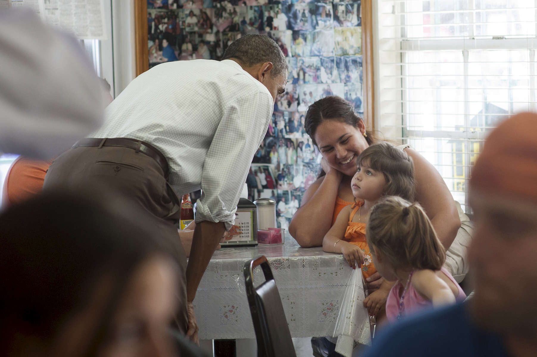 September 8, 2012 - Tampa, FL: President Barack Obama greets a young family at the West Tampa Sandwich Shop and Restaurant in Tampa, FL. (Scout Tufankjian for Obama for America/Polaris)