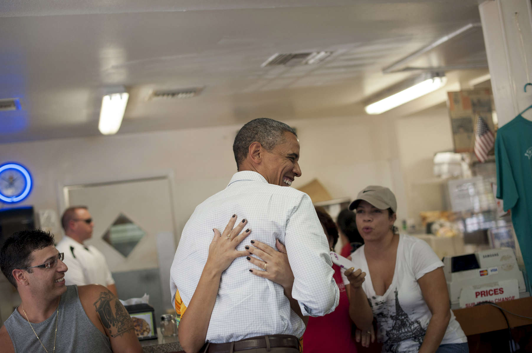 September 8, 2012 - Tampa, FL: A woman at the West Tampa Sandwich Shop and Restaurant in Tampa, FL embraces President Barack Obama during a visit to the shop. (Scout Tufankjian for Obama for America/Polaris)