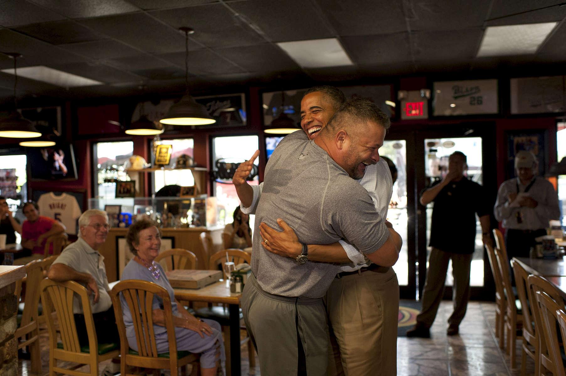 September 9, 2012 - Fort Pierce, FL: Big Apple Pizza owner Scott Van Duzer hugs President Barack Obama just before hoisting him up in an exuberant bear hug during the President's surprise visit to Van Duzer's shop in Ft. Pierce, Florida. (Scout Tufankjian for Obama for America/Polaris)