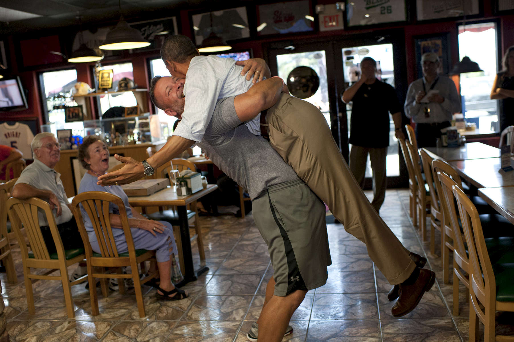 September 9, 2012 - Fort Pierce, FL: Big Apple Pizza owner Scott Van Duzer hoists President Barack Obama up in an exuberant bear hug during the President's surprise visit to Van Duzer's shop in Ft. Pierce, Florida. (Scout Tufankjian for Obama for America/Polaris)