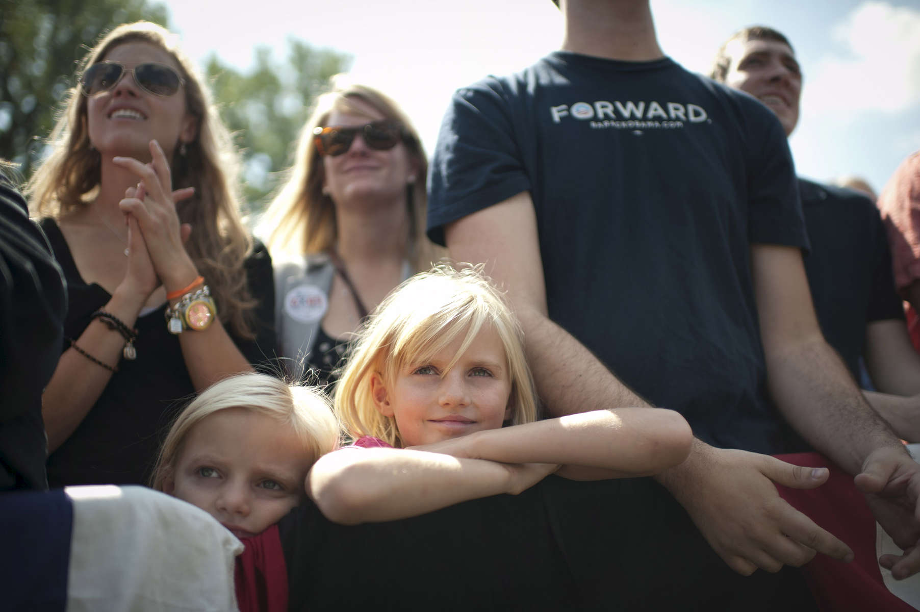 September 13, 2012 - Golden, CO: A family listens as President Barack Obama speaks at a campaign event in Golden, CO. (Scout Tufankjian for Obama for America/Polaris)