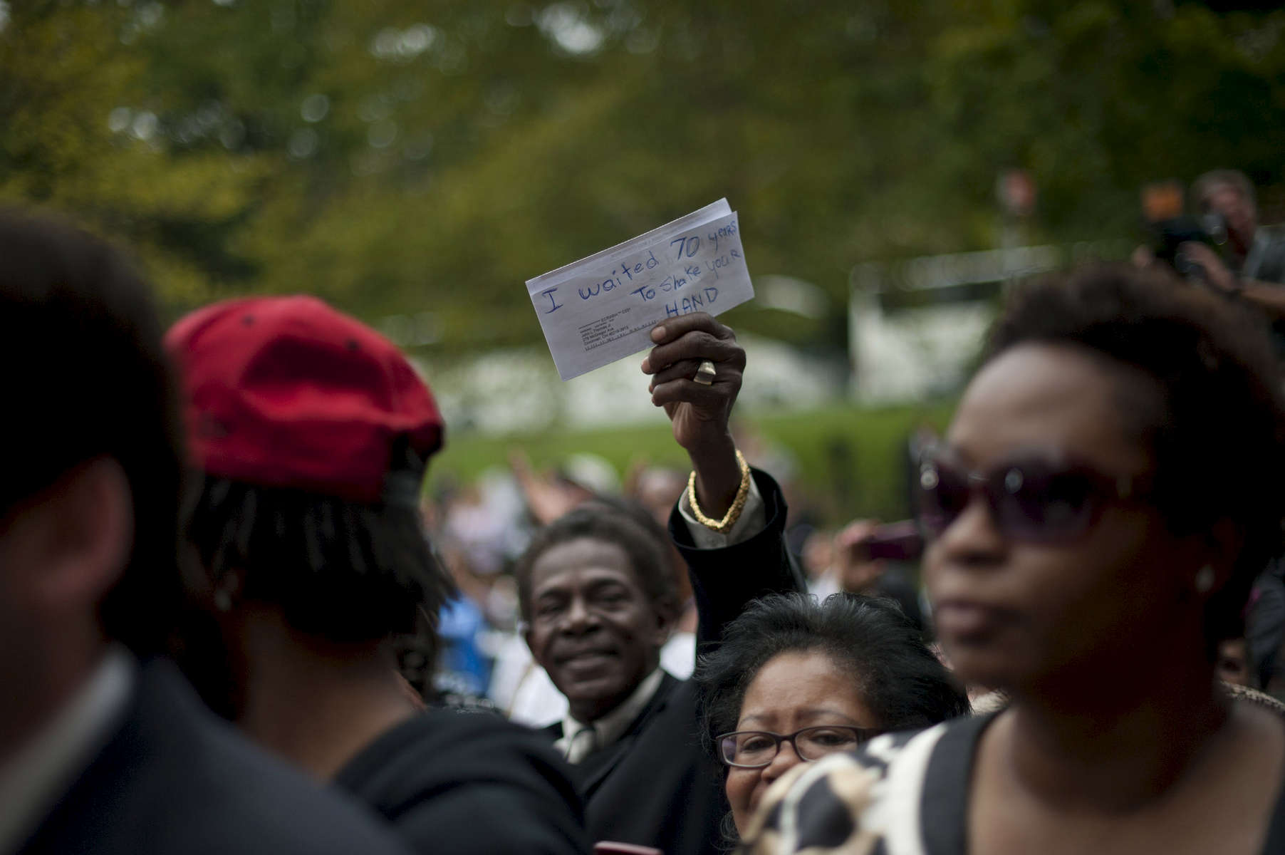 September 17, 2012 - Mt. Adams, OH: An elderly man holds up a handwritten sign reading {quote}I waited 70 years to shake your hand{quote}  during an Obama campaign event in Ohio. (Scout Tufankjian for Obama for America/Polaris)