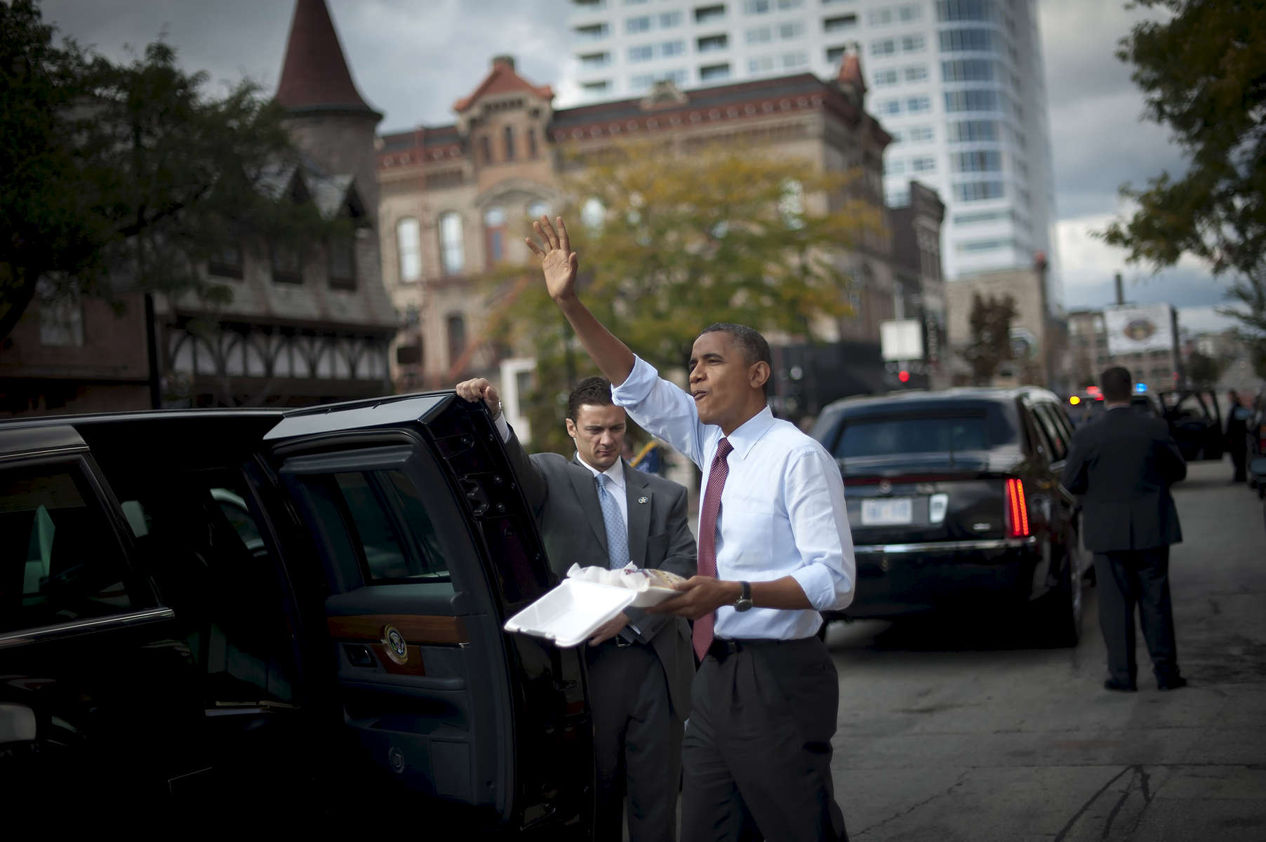 September 22, 2012 - Milwaukee, WI: President Barack Obama waves to supporters after leaving Usinger's Fine Sausage in Milwaukee, WI.  (Scout Tufankjian for Obama for America/Polaris)