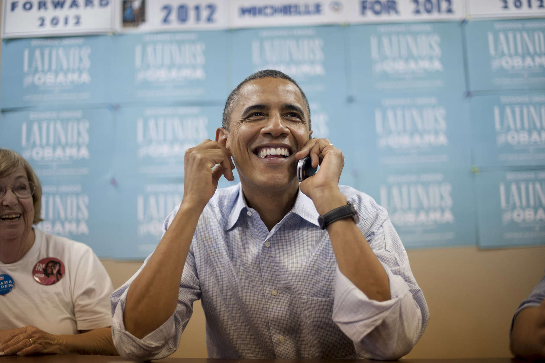 October 1, 2012 - Henderson, NV: President Barack Obama grins as he calls potential supporters from a campaign field office in Henderson, NV. (Scout Tufankjian for Obama for America/Polaris)