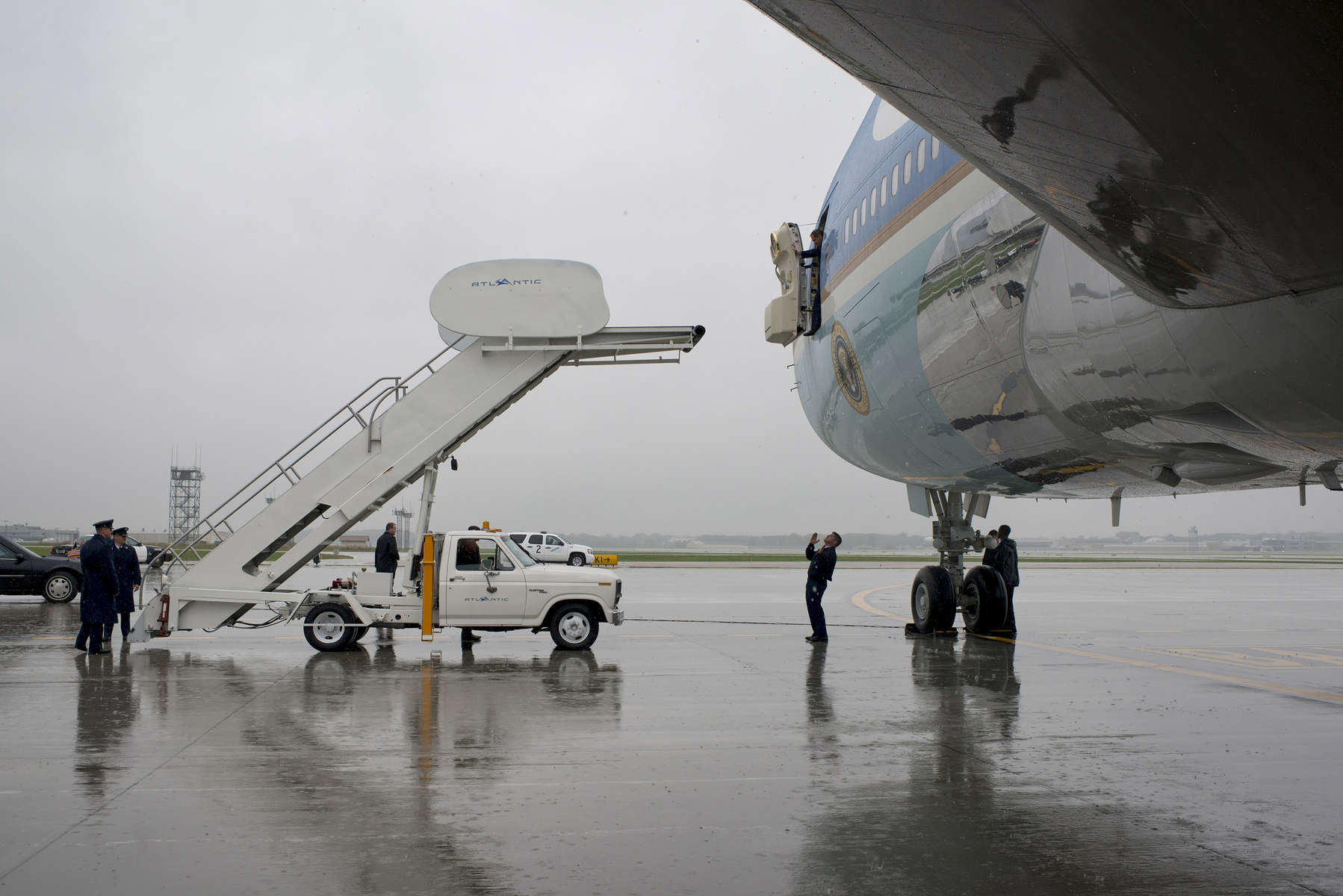October 5, 2012 - Cleveland, OH- Air Force One and ground staff at Hopkins Airport in Cleveland attempt to line the steps up with Air Force One on a rainy day. (Scout Tufankjian for Obama for America/Polaris)