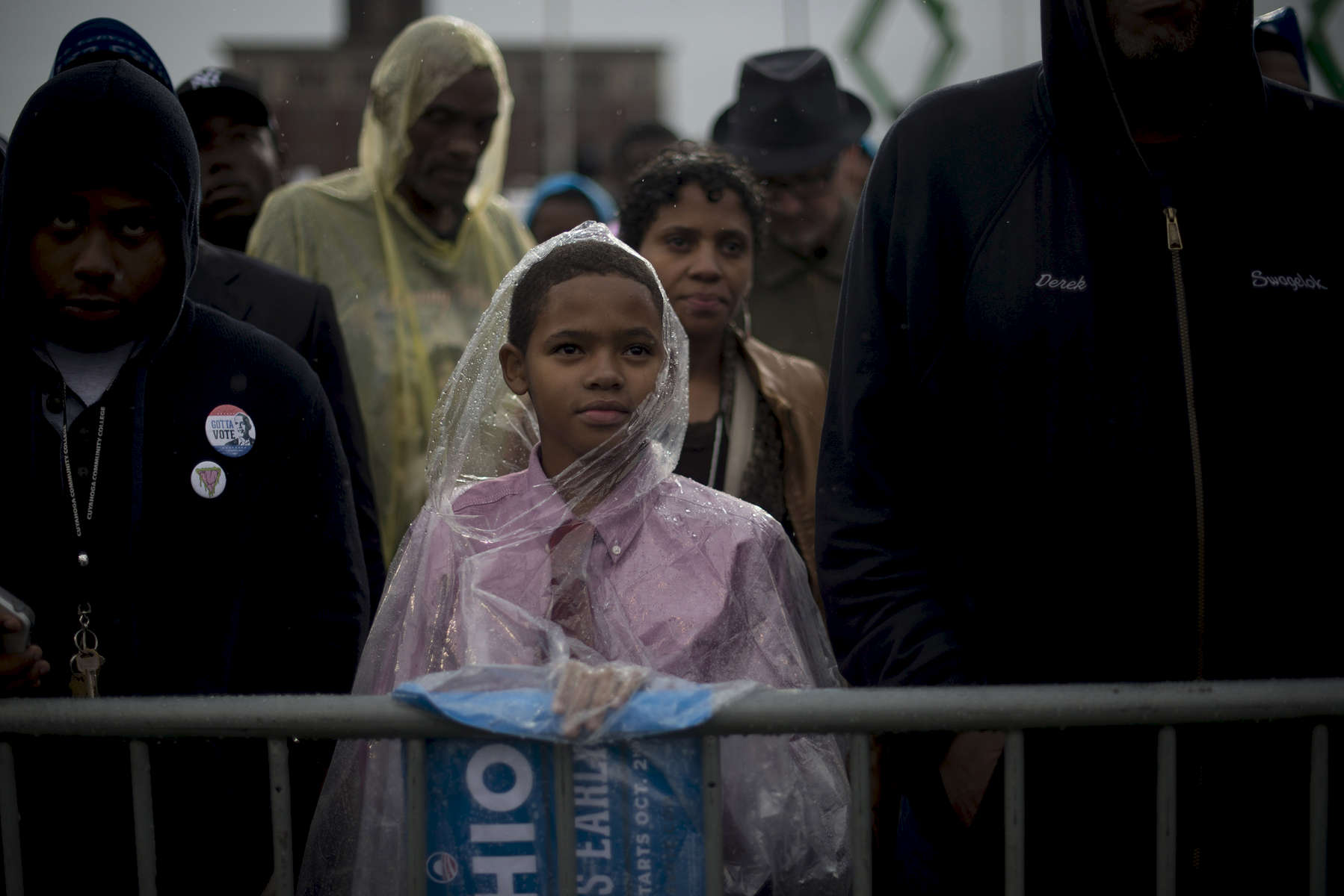October 5, 2012 - Cleveland, OH- A young supporter listens to President Barack Obama speak during a rain soaked rally in Cleveland, OH.  (Scout Tufankjian for Obama for America/Polaris)