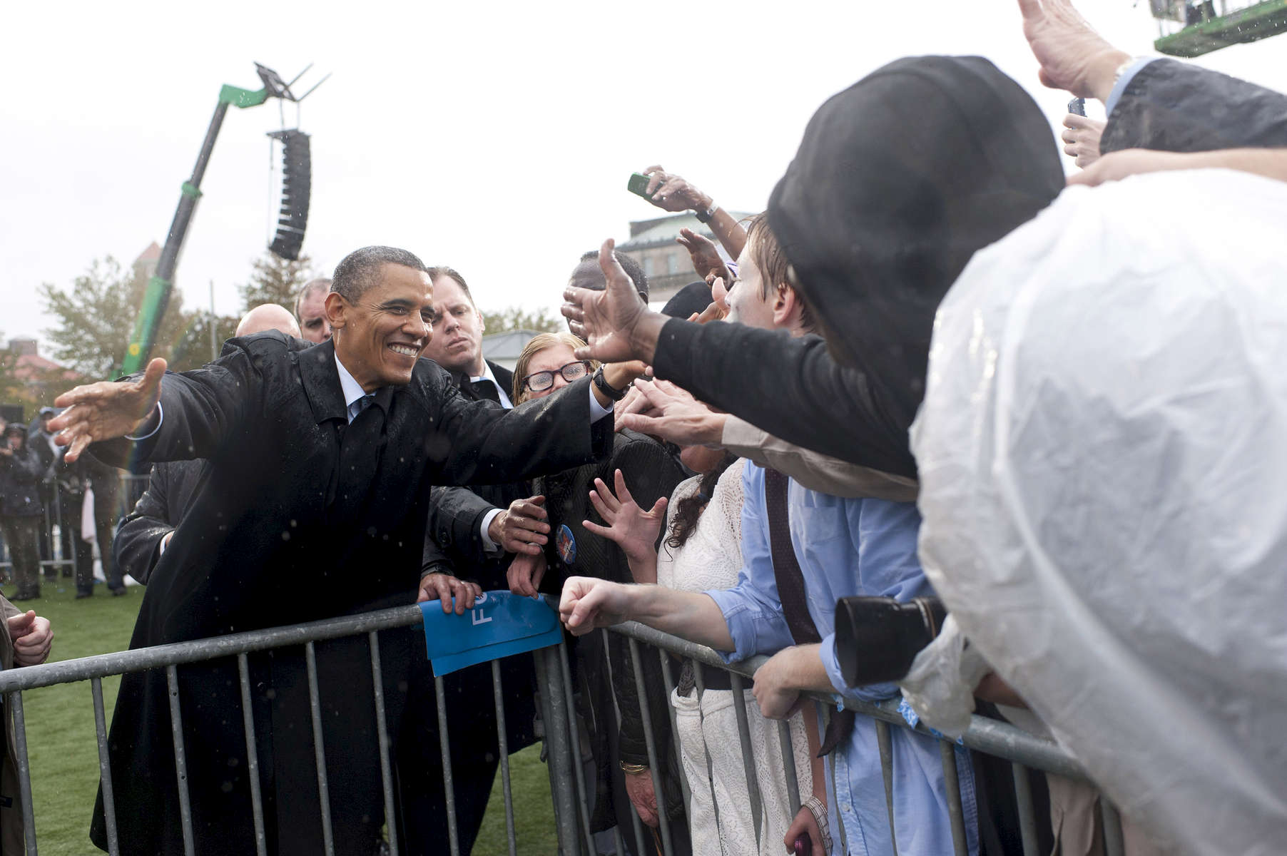 October 5, 2012 - Cleveland, OH- President Barack Obama high-fives a supporter during a rain soaked rally in Cleveland, OH.  (Scout Tufankjian for Obama for America/Polaris)