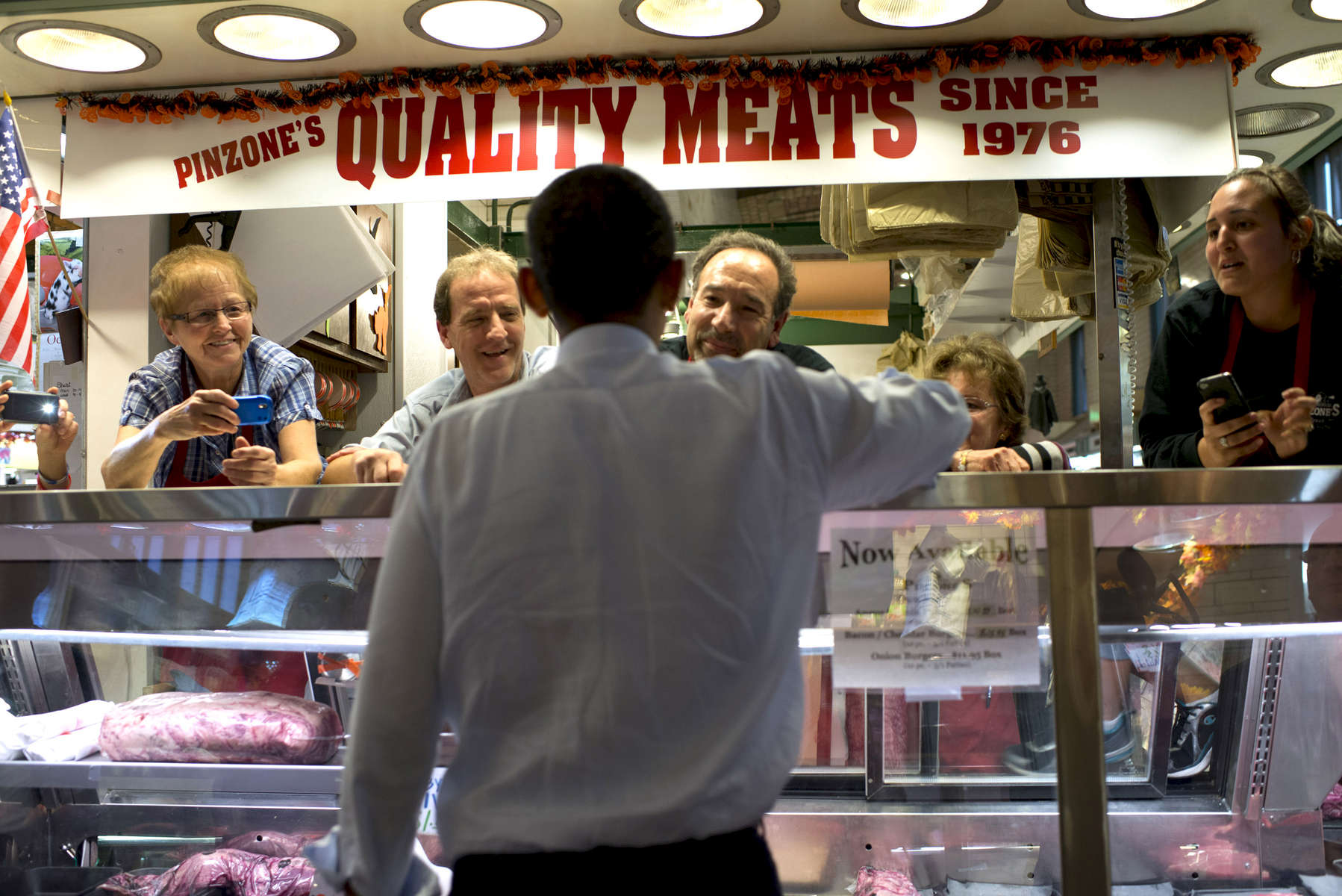 October 5, 2012 - Cleveland, OH- President Barack Obama chats with the proprietors of Pinzone's Quality Meats during a visit to the Cleveland West Side Market Cleveland, OH.  (Scout Tufankjian for Obama for America/Polaris)