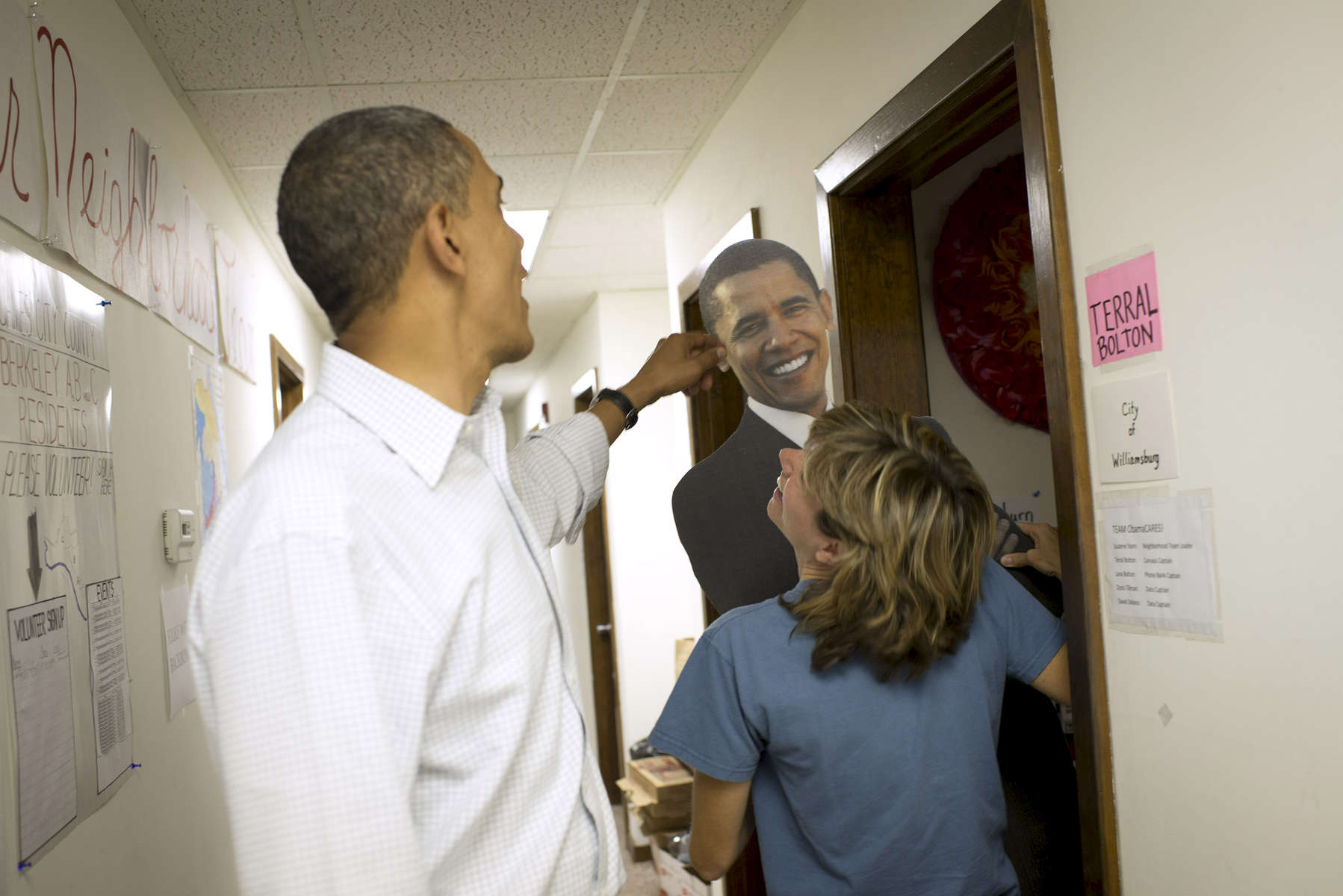 October 14, 2012 - Williamsburg, VA - President Barack Obama tweaks the ear of a cardboard cutout of himself at a campaign field office in Williamsburg, VA.  (Scout Tufankjian for Obama for America/Polaris)