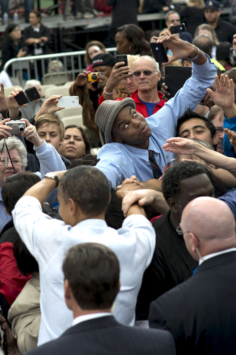 October 19, 2012 - Fairfax, VA:  A young man checks himself out in his camera as he shakes hands with President Barack Obama after a campaign event in Fairfax, VA. (Scout Tufankjian for Obama for America/Polaris)