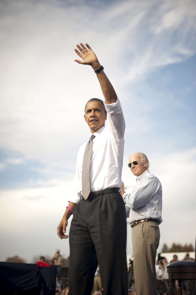 October 23, 2012- Dayton, OH: President Barack Obama and Vice President Joe Biden wave to supporters after a campaign event in Dayton, OH. (Scout Tufankjian for Obama for America/Polaris)