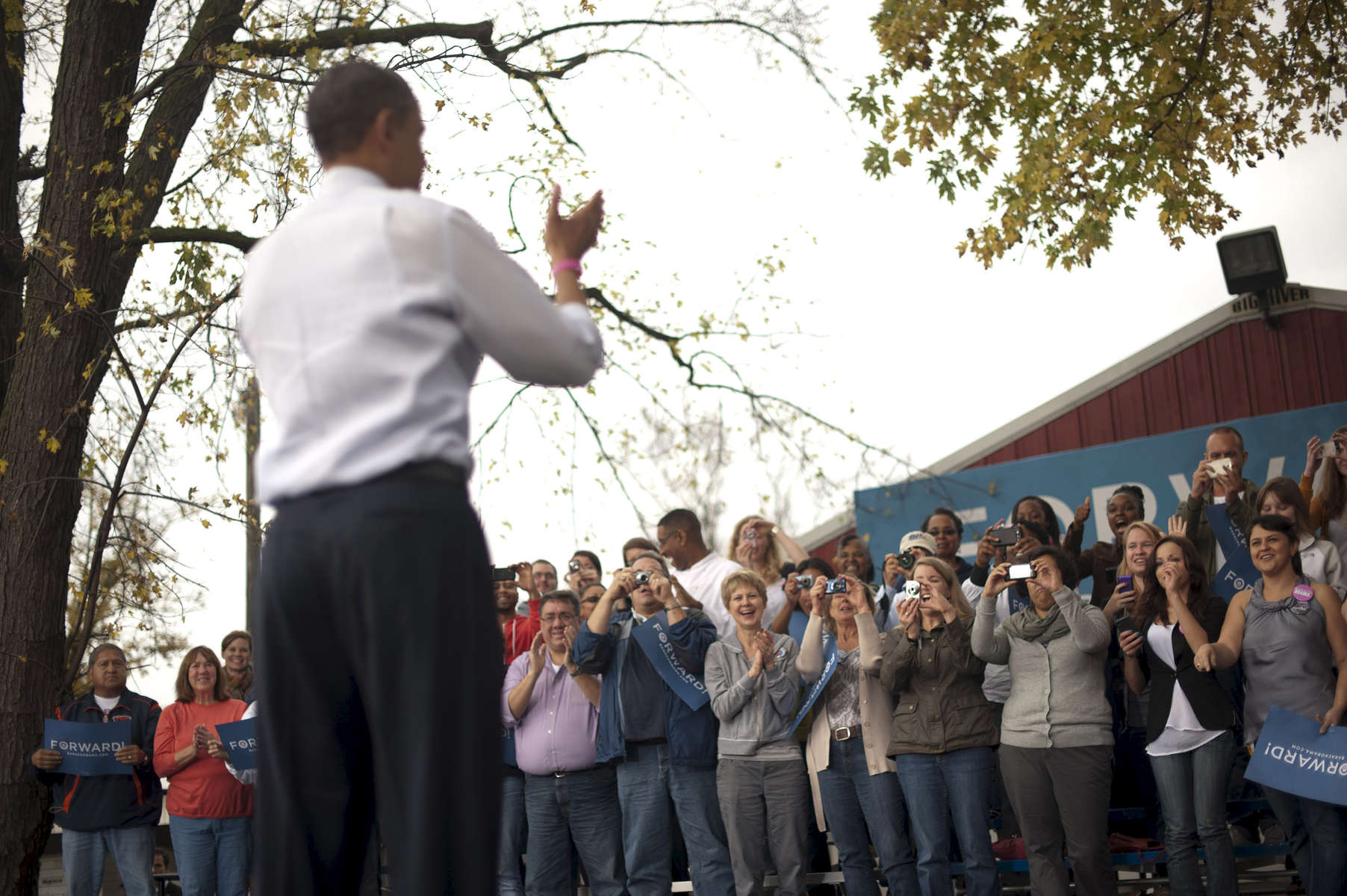October 24, 2012 - Davenport, IA:  President Barack Obama waves to supporters at a campaign event in Davenport, IA,  his first stop on a whirlwind 48 hours of straight campaigning. (Scout Tufankjian for Obama for America/Polaris)