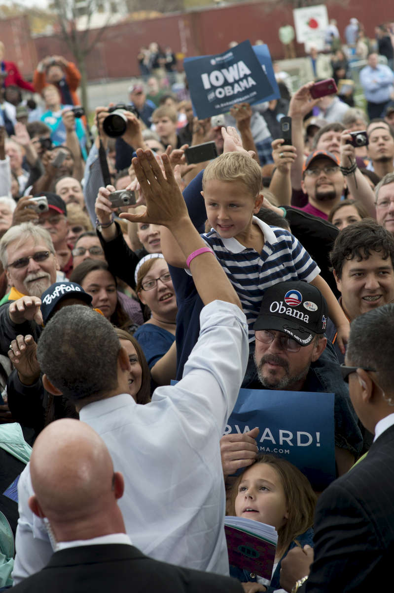 October 24, 2012 - Davenport, IA:  President Barack Obama high-fives a boy at a campaign event in Davenport, IA,  his first stop on a whirlwind 48 hours of straight campaigning. (Scout Tufankjian for Obama for America/Polaris)