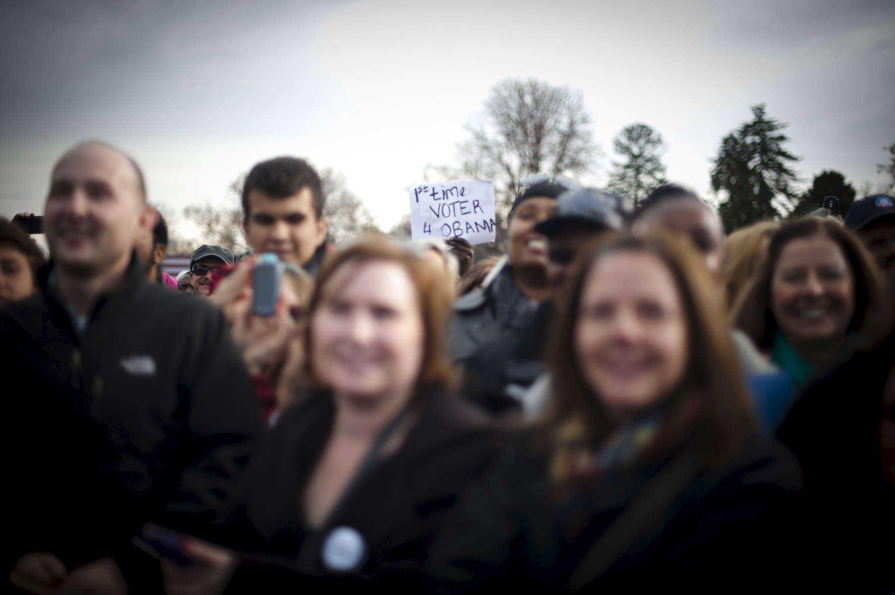 October 24, 2012-  Denver, CO: A supporter waves a home-made sign reading {quote}1st time voter 4 Obama{quote} as President Barack Obama speaks at a rally in Denver, his second stop on a 48 hour swing of straight events. (Scout Tufankjian for Obama for America/Polaris)
