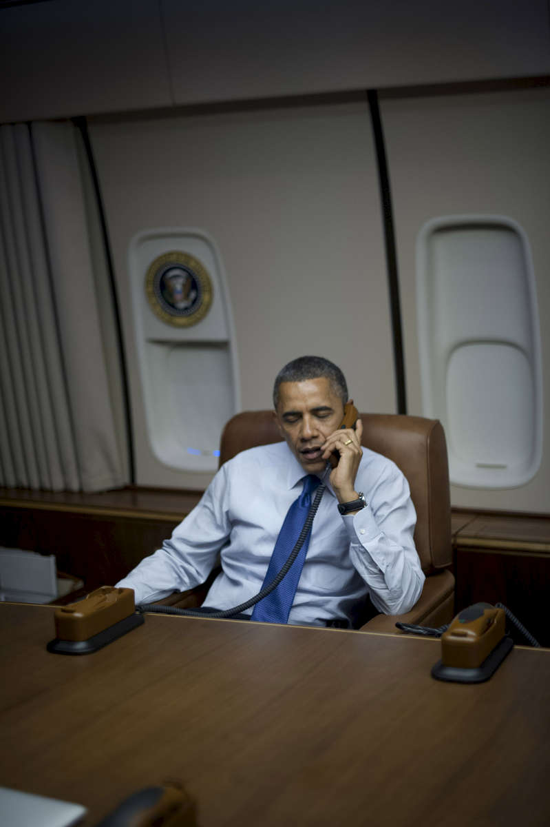 October 24, 2012 - En route to Los Angeles, CA: President Barack Obama speaks on the phone in the conference room on Air Force One en route to Los Angeles, CA from Denver, CO during a 48 hour swing of straight events. (Scout Tufankjian for Obama for America/Polaris)