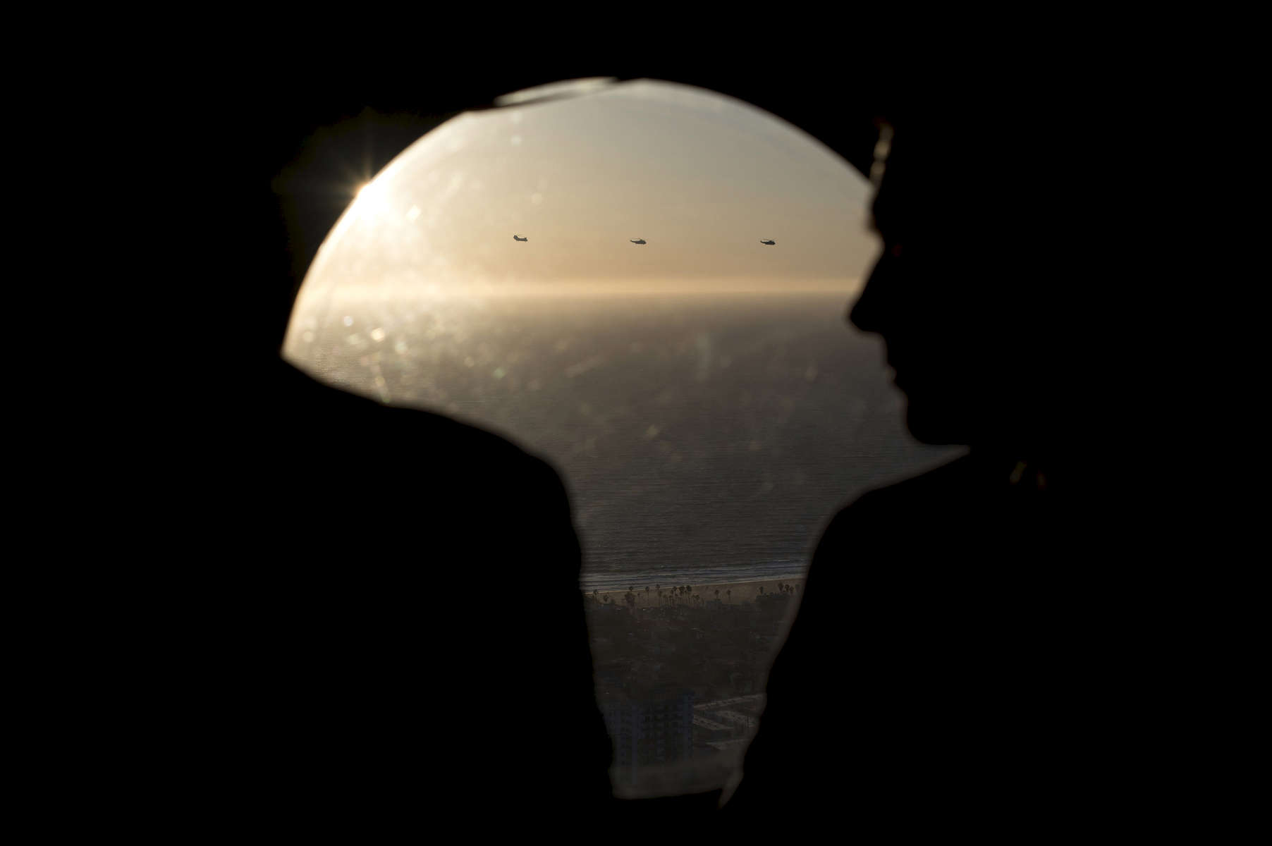 October 24, 2012 - Los Angeles, CA: Marine One can be seen flying over the beach on Los Angeles from one of the Marine support helicopters carrying staff and Secret Service. (Scout Tufankjian for Obama for America/Polaris)