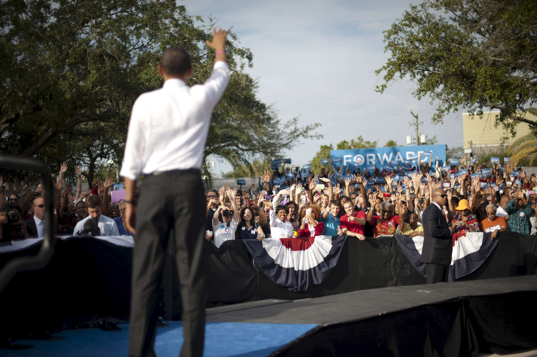 October 25, 2012 - Tampa, FL:  President Barack Obama waves to supporters after a rally in Tampa's Centennial Park during a 48 hour straight swing of campaign events. (Scout Tufankjian for Obama for America/Polaris)