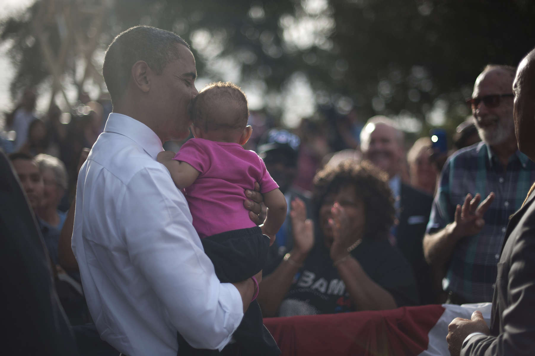 October 25, 2012 - Tampa, FL:  President Barack Obama kisses a small baby after a rally in Tampa's Centennial Park during a 48 hour straight swing of campaign events. (Scout Tufankjian for Obama for America/Polaris)