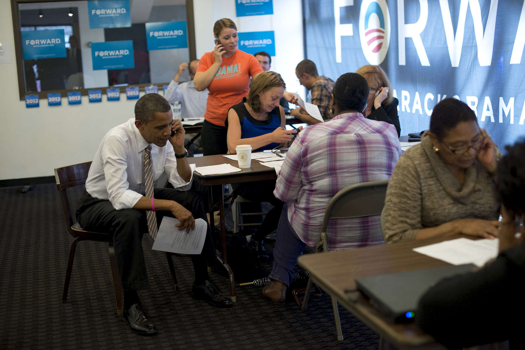 October 25, 2012 - Chicago, IL: President Barack Obama makes phone calls at a campaign field office in his Hyde Park neighborhood. (Scout Tufankjian for Obama for America/Polaris)