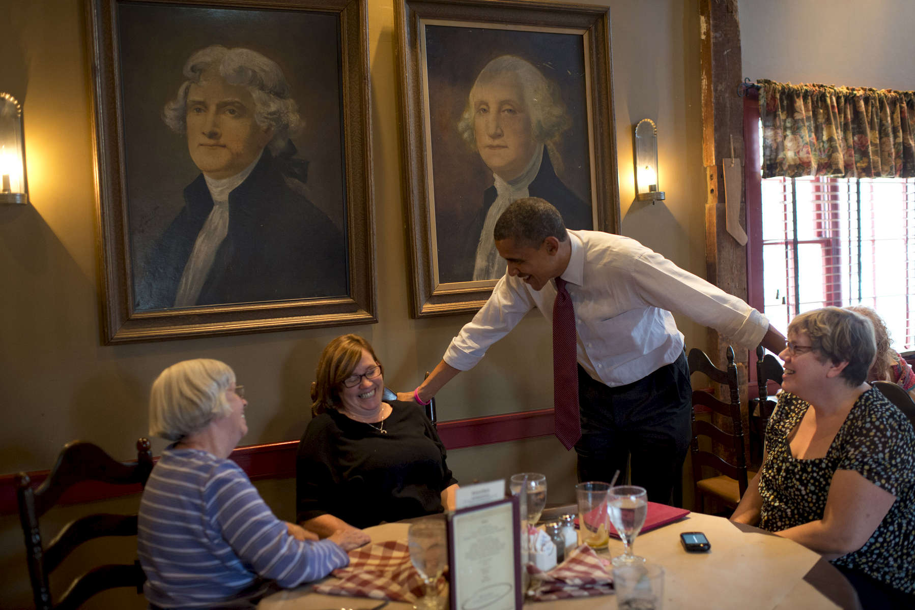 October 27, 2012 - Merrimack, NH:  President Barack Obama chats with patrons at the Common Man Pub in Merrimack, NH.  (Scout Tufankjian for Obama for America/Polaris)