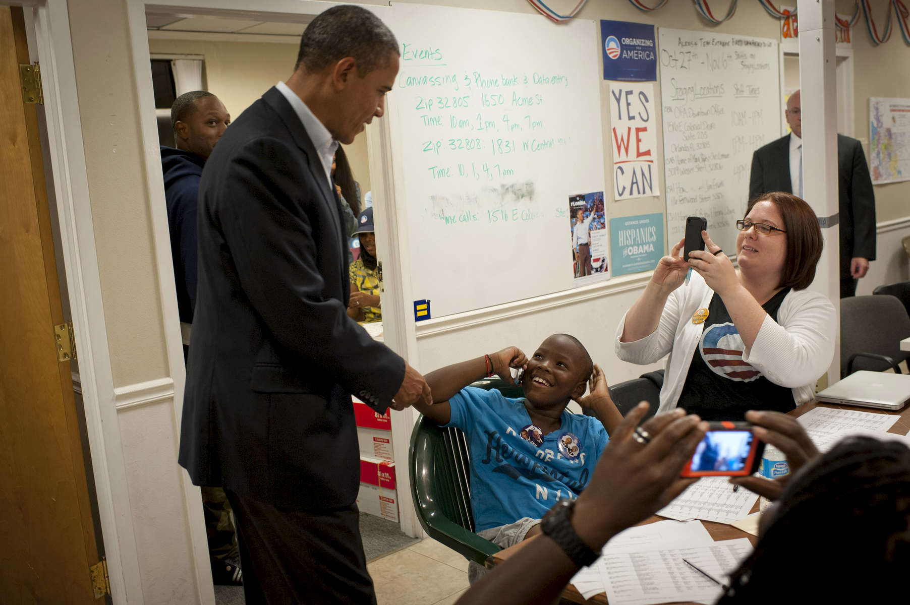 October 28, 2012 - Orlando, FL:  President Barack Obama surprises a young boy who is making phone calls to voters at a campaign field office in Orlando, FL. (Scout Tufankjian for Obama for America/Polaris)