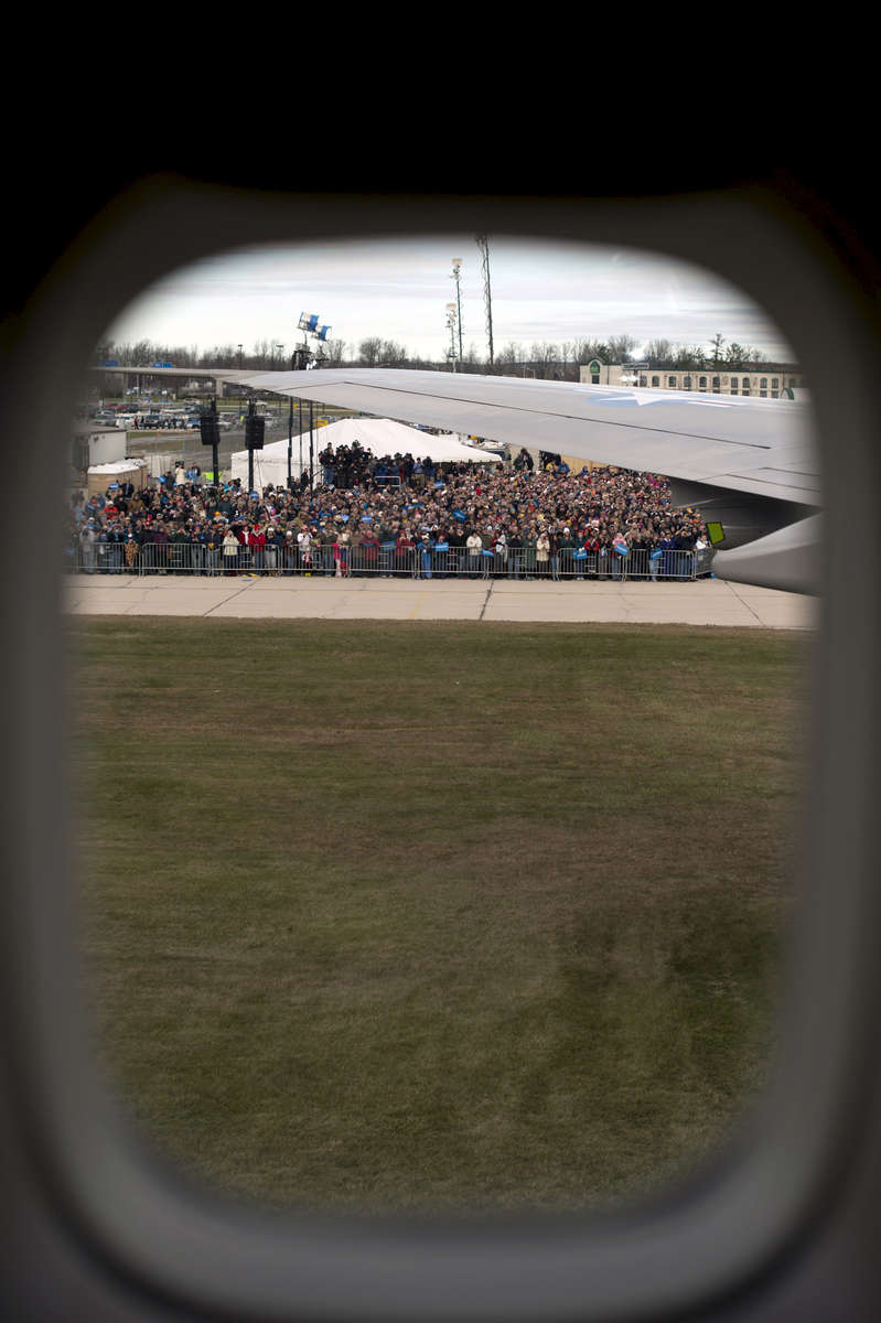 November 1, 2012 - Green Bay, WI: A crowd can be seen awaiting President Barack Obama through a window in Air Force One.  The President held a tarmac rally in Green Bay a few days before the 2012 election.  (Scout Tufankjian for Obama for America/Polaris)