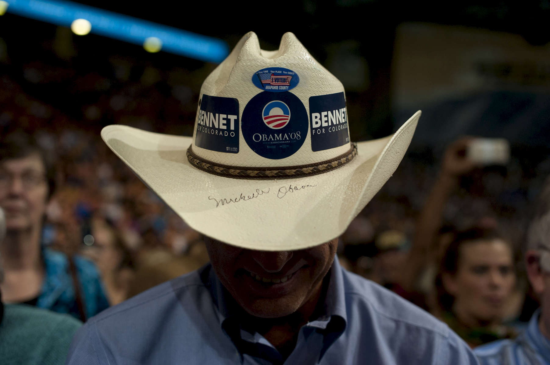 November 1, 2012 - Boulder, CO:  A supporter wears a cowboy hat signed by Michelle Obama at a rally for President Barack Obama in Boulder, CO a few days before the 2012 election. (Scout Tufankjian for Obama for America/Polaris)