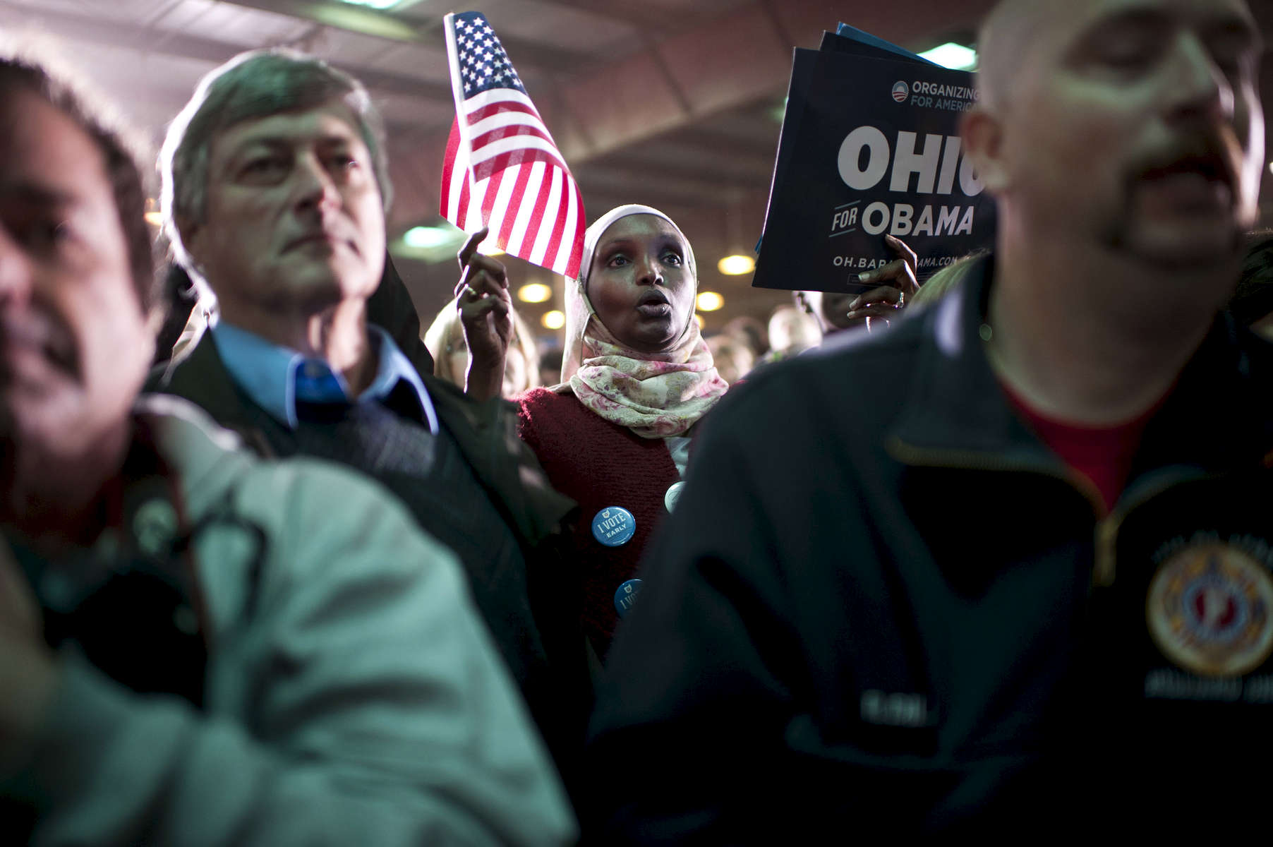 November 2, 2012 - Hilliard, OH: A woman waves a flag as she listens to President Barack Obama speak at a rally in the small town of Hilliard, OH a few days before the 2012 election.  (Scout Tufankjian for Obama for America/Polaris)