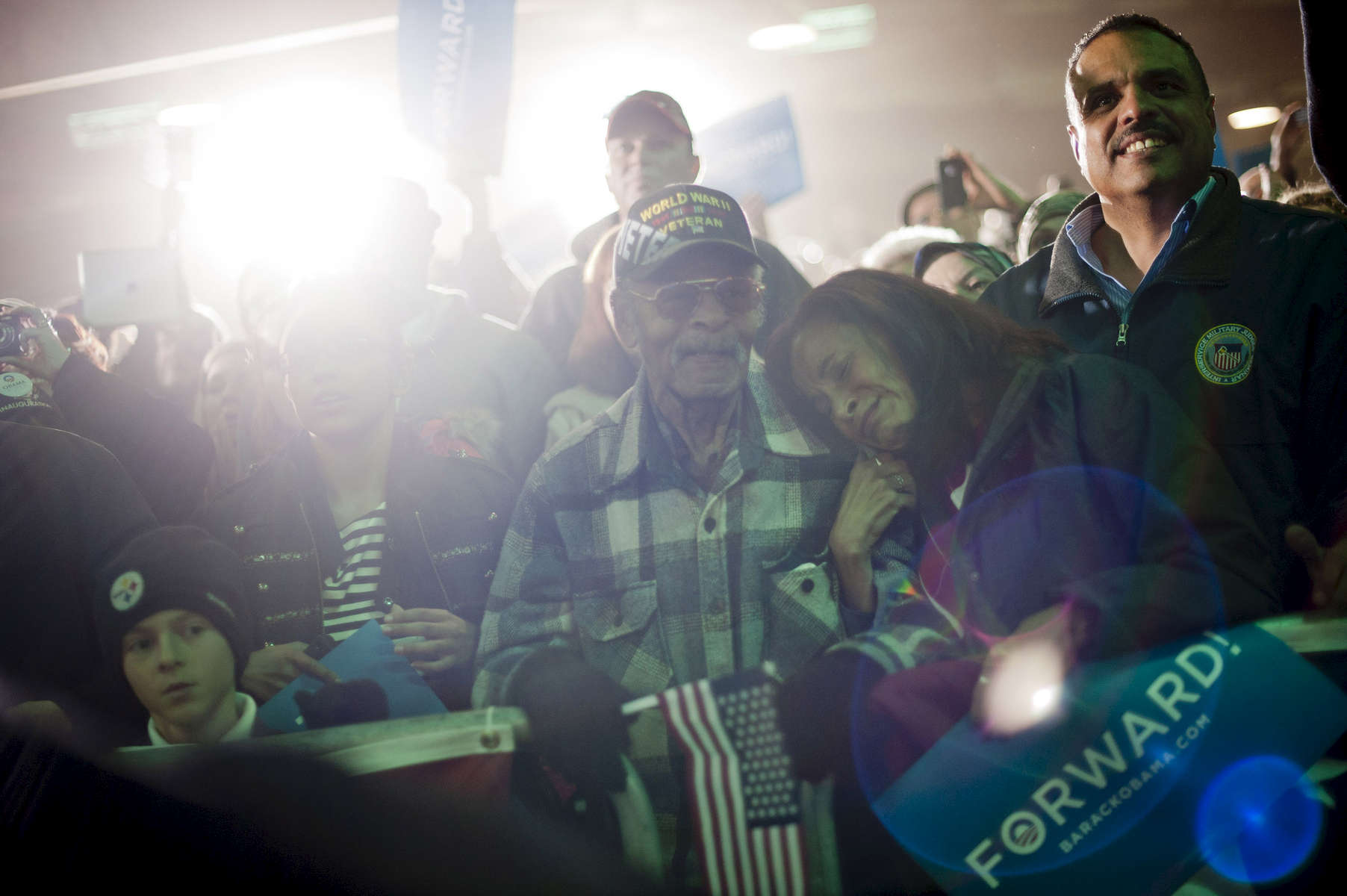 November 2, 2012 - Hilliard, OH: A woman weeps as she embraces her father, a veteran, during a campaign event for President Barack Obama in the small town of Hilliard, OH a few days before the 2012 election.  (Scout Tufankjian for Obama for America/Polaris)