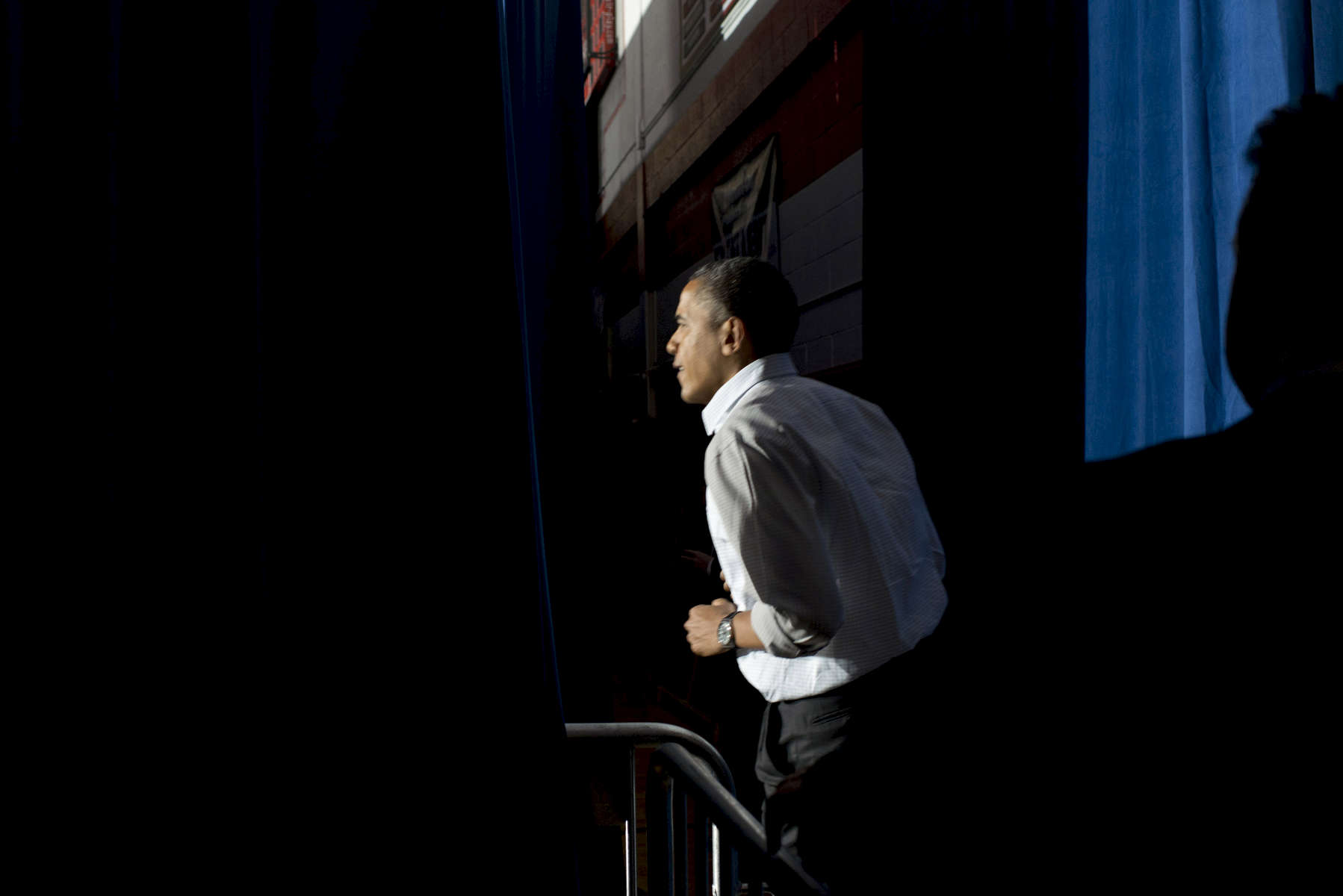 November 3, 2012 - Mentor, OH:  President Barack Obama runs onstage at a campaign event in the small town of Mentor, OH a few days before the 2012 election.  (Scout Tufankjian for Obama for America/Polaris)